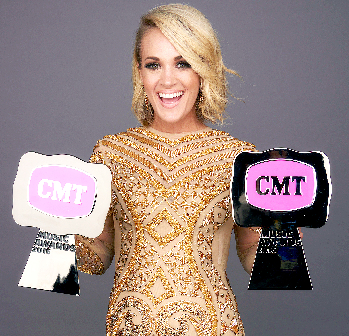 Carrie Underwood poses with her CMT Awards in 2016.