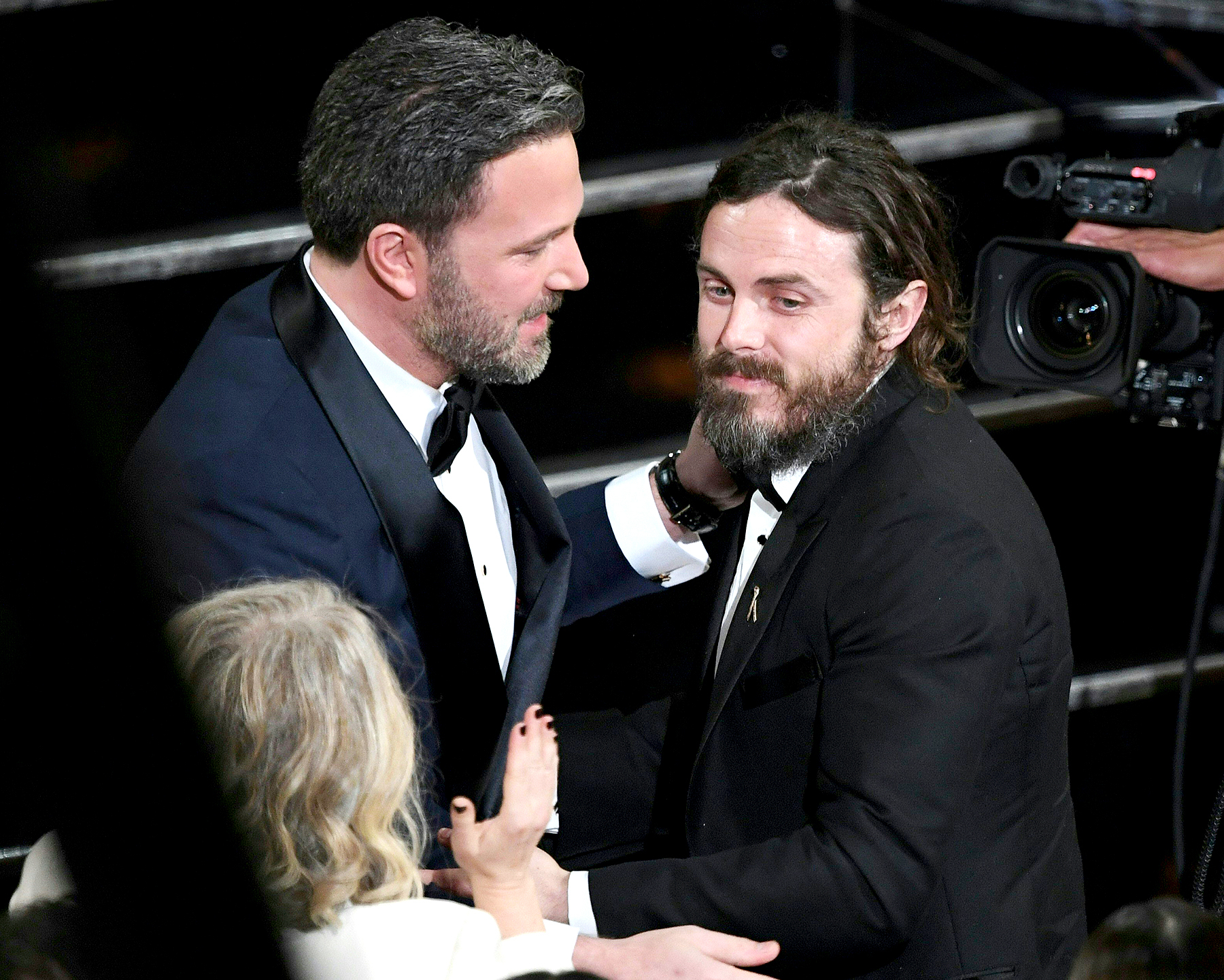 "Winner for Best Actor ""Manchester By The Sea"" Casey Affleck (R) is embraced by his brother Ben Affleck on stage at the 89th Oscars on Feb. 26, 2017 in Hollywood, California."