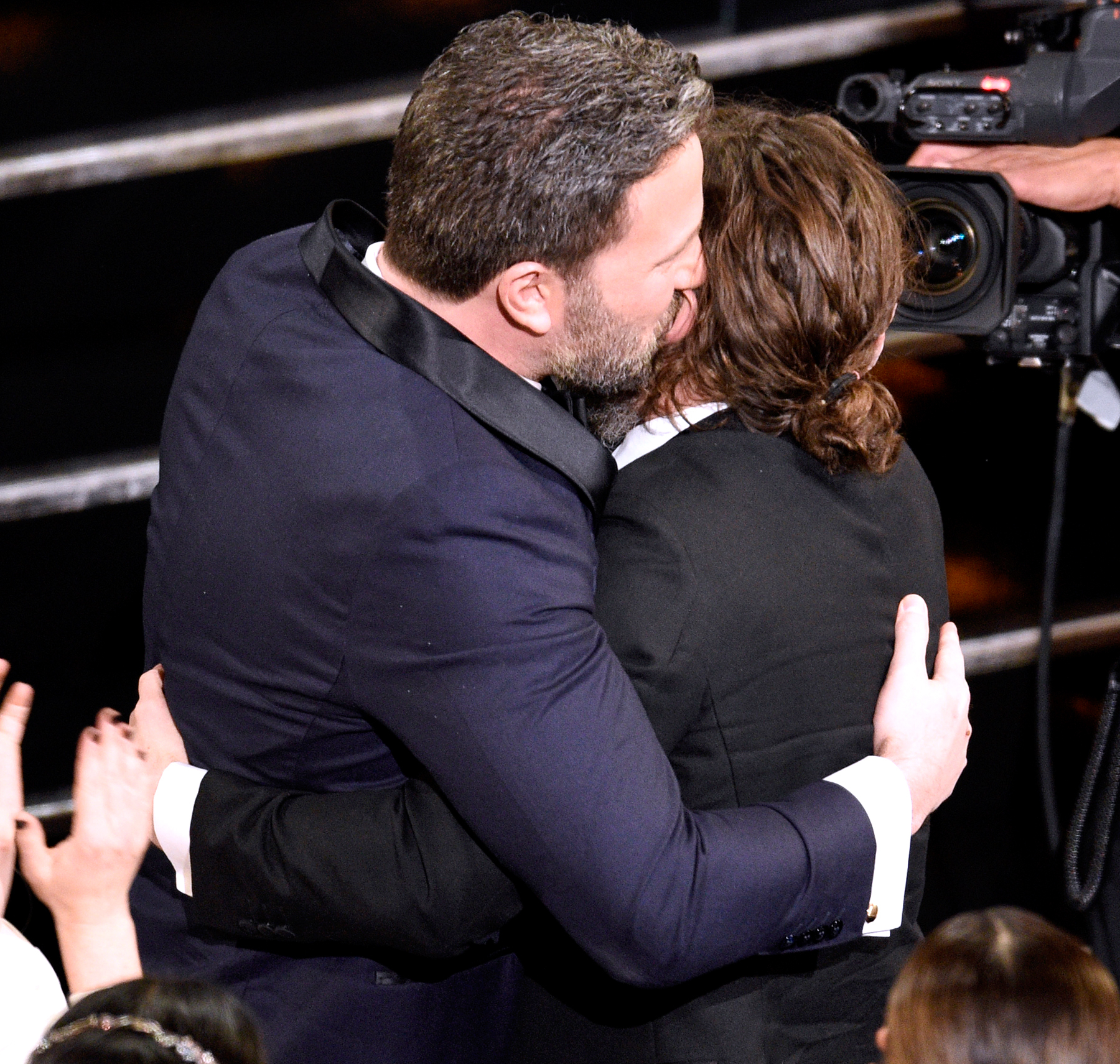 Ben Affleck, left, congratulates Casey Affleck as he accepts the award for best actor in a leading role for 'Manchester by the Sea' at the Oscars on Sunday, Feb. 26, 2017, at the Dolby Theatre in Los Angeles.