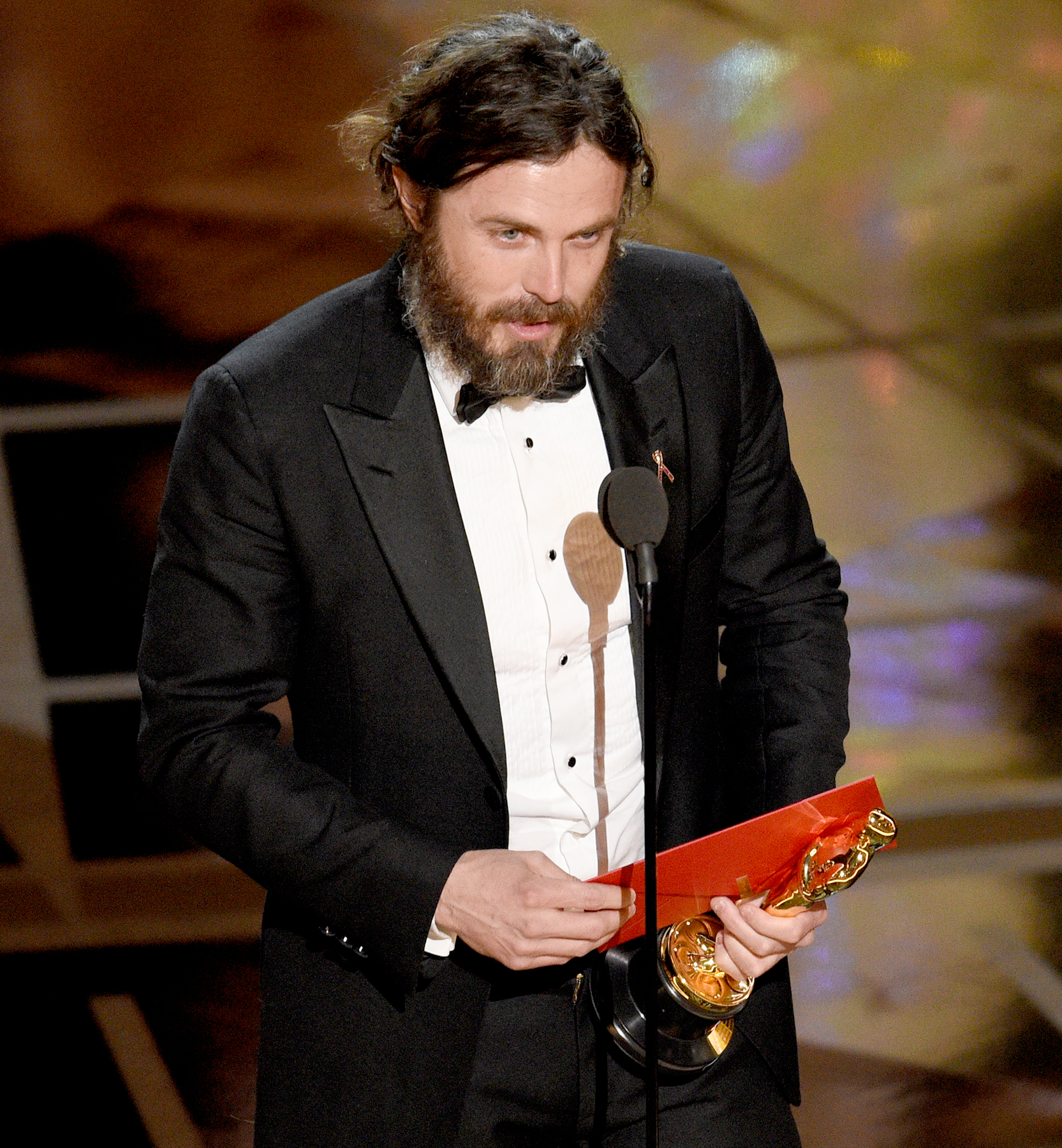 """Casey Affleck accepts the award for best actor in a leading role for """"Manchester by the Sea"""" at the Oscars on Sunday, Feb. 26, 2017, at the Dolby Theatre in Los Angeles."""
