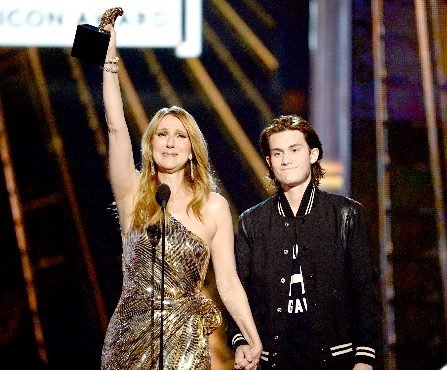 Celine Dion accepts the Billboard Icon-Award from son Rene Charles Angelil onstage during the 2016 Billboard Music Awards.