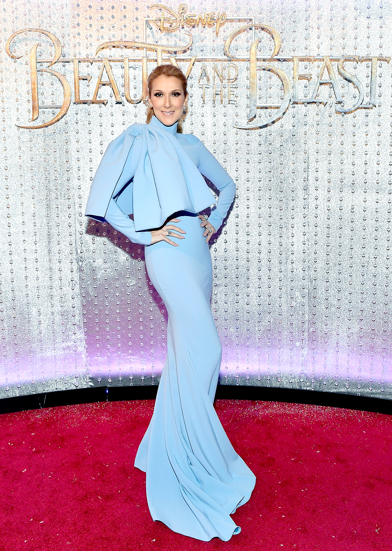 "Celine Dion arrives at the world premiere of Disney's new live-action ""Beauty and the Beast"" photographed in front of the Swarovski crystal wall at the El Capitan Theatre on March 2, 2017 in Hollywood, California."