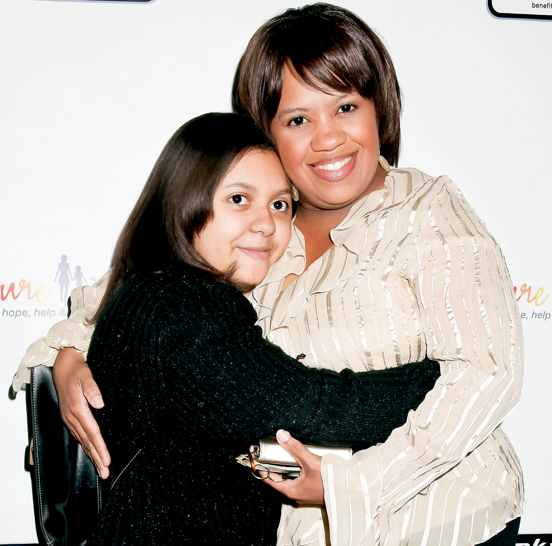 Chandra Wilson and daughter Sarina attend the Rock-N-Roll Marathon pre-race benefit dinner with CureMito! and Chandra Wilson at Brookside Golf Club on February 18, 2012 in Pasadena, California.