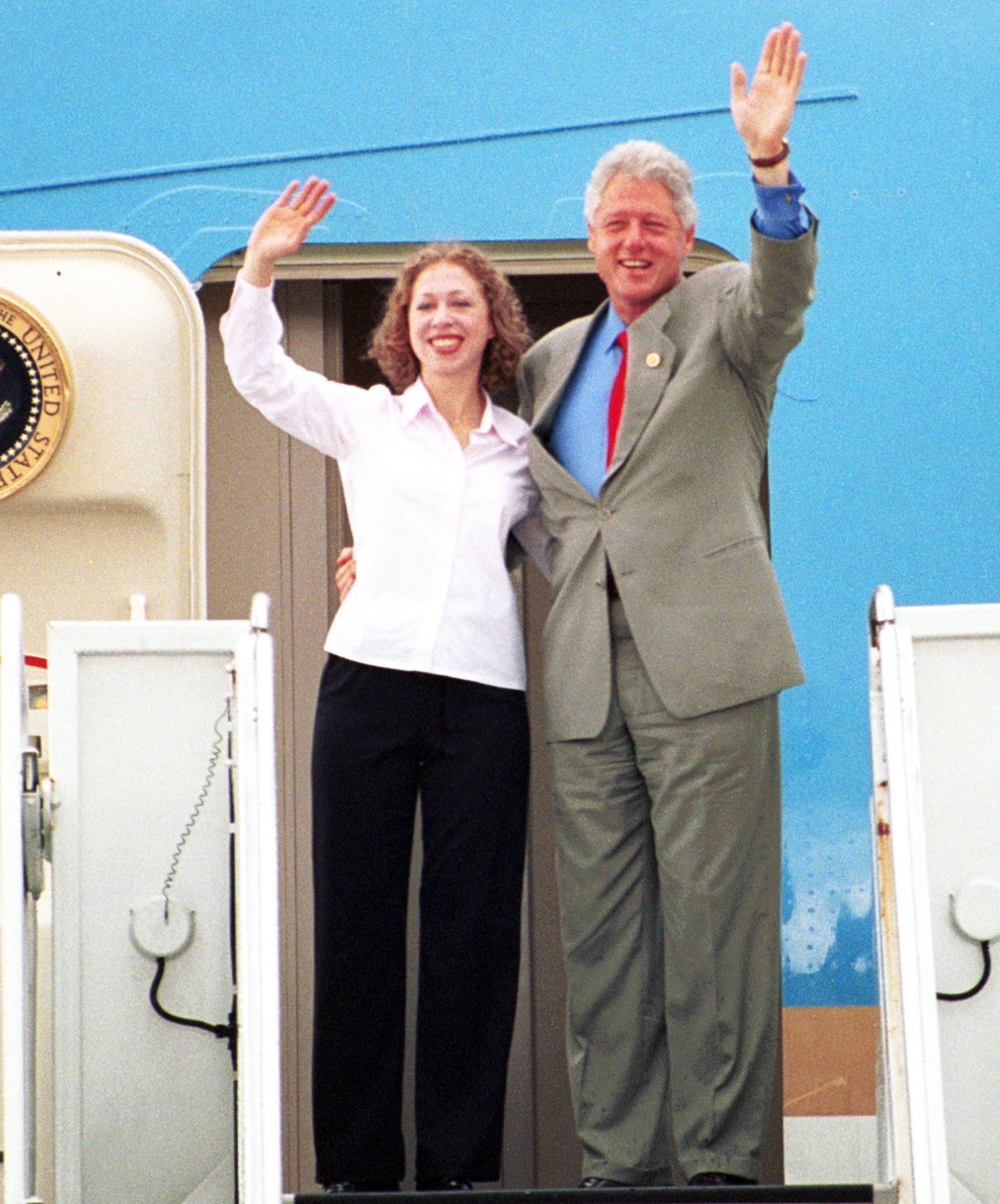 U.S. President Bill Clinton, right, and his daughter Chelsea wave goodbye July 23, 2000