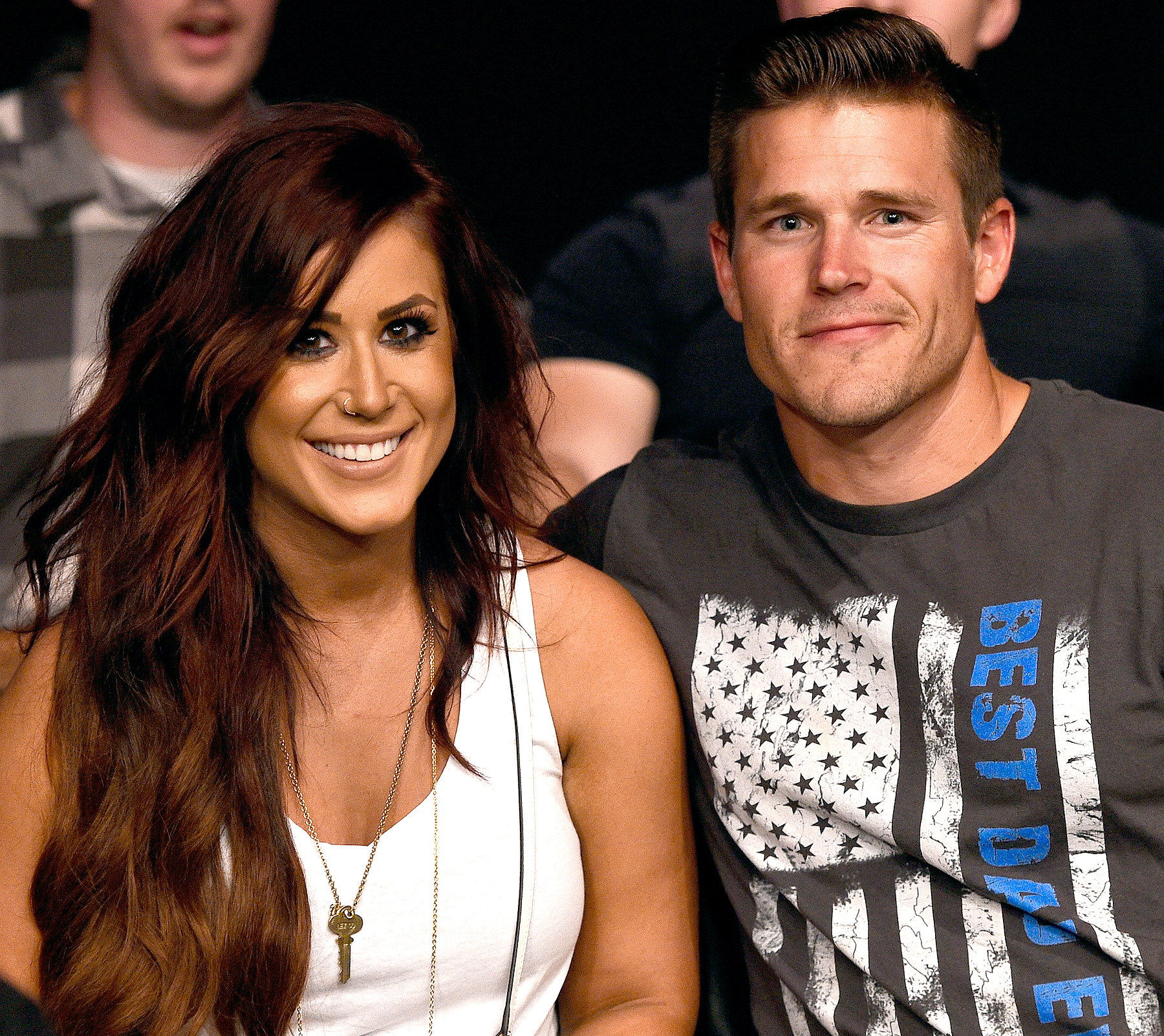 Chelsea Houska and her fiance Cole DeBoer watch the fights during the UFC Fight Night event on July 13, 2016 at Denny Sanford Premier Center in Sioux Falls, South Dakota.