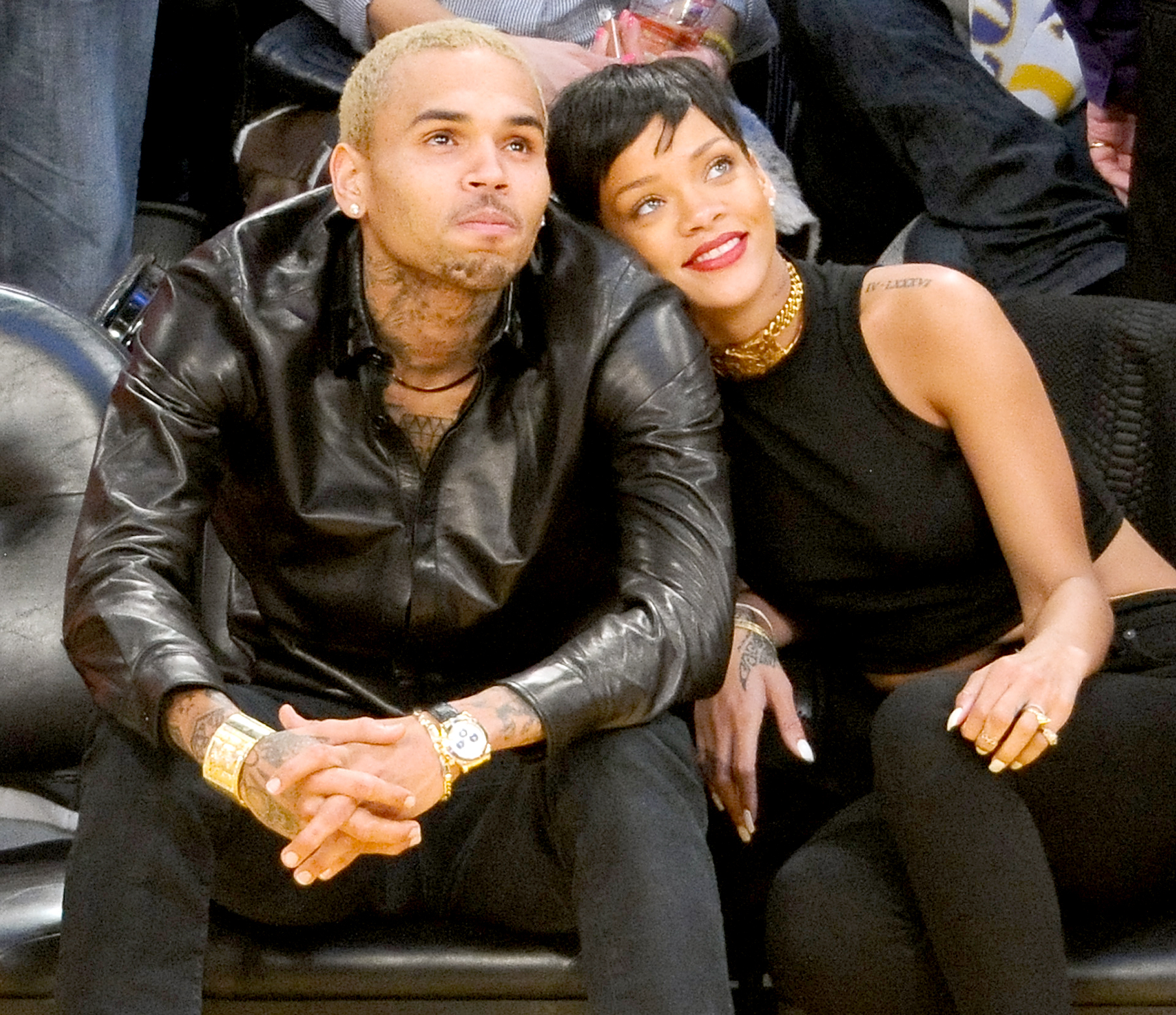 Chris Brown and Rihanna attend a basketball game between the New York Knicks and the Los Angeles Lakers at Staples Center on December 25, 2012 in Los Angeles, California.