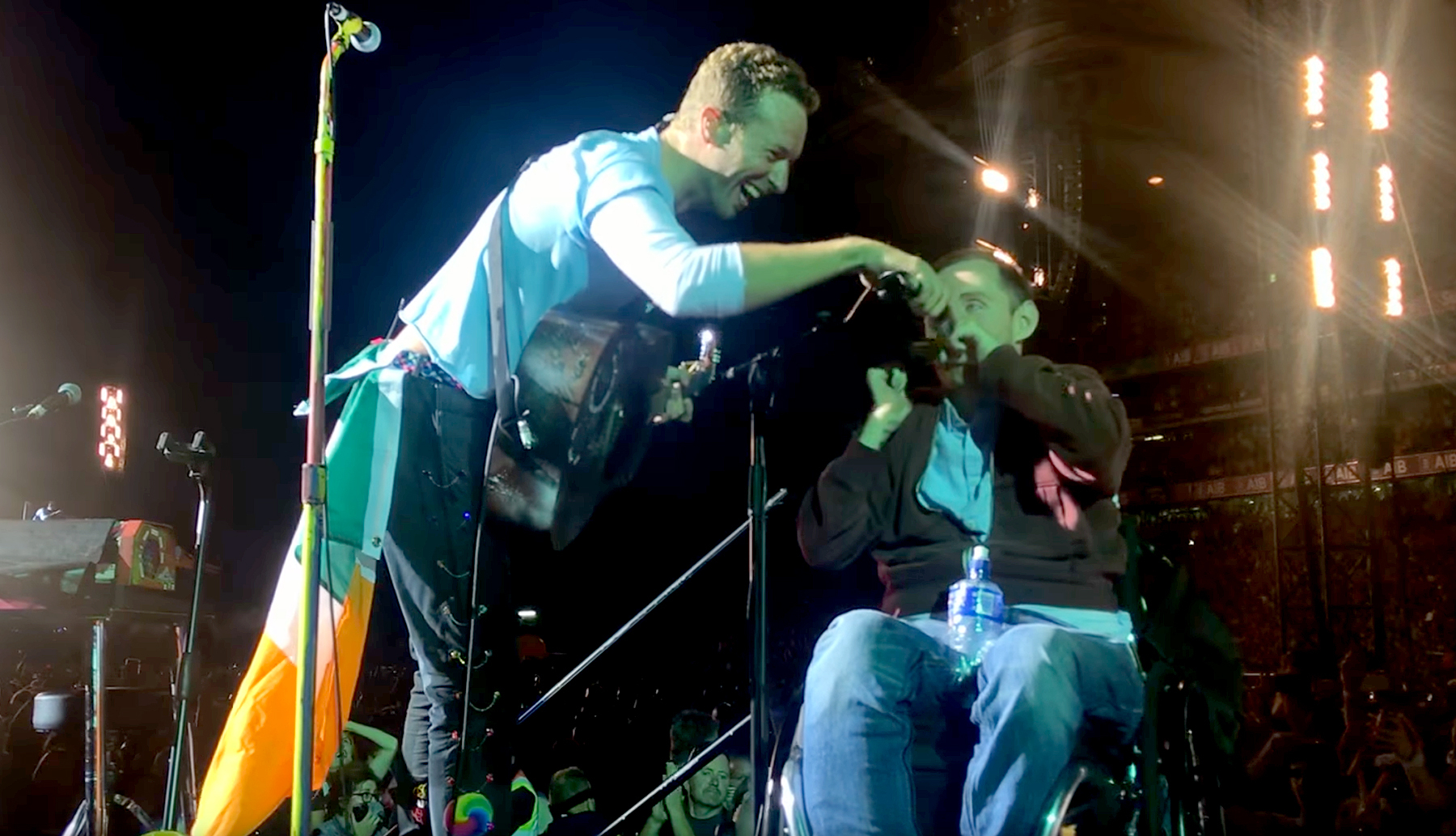 Chris Martin and fan.