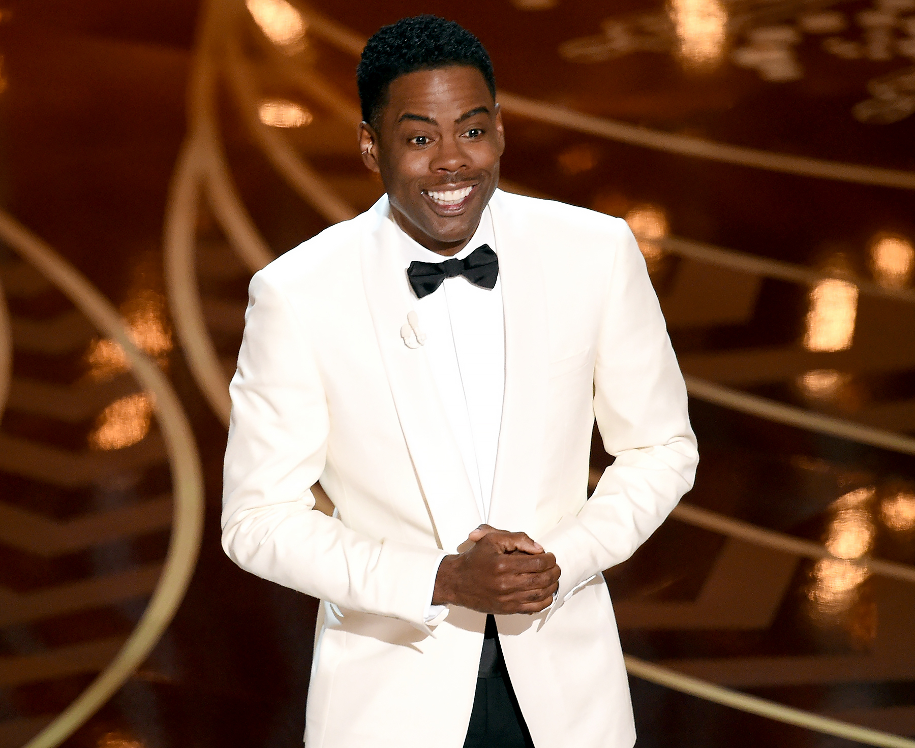 Chris Rock speaks onstage during the 88th Annual Academy Awards.