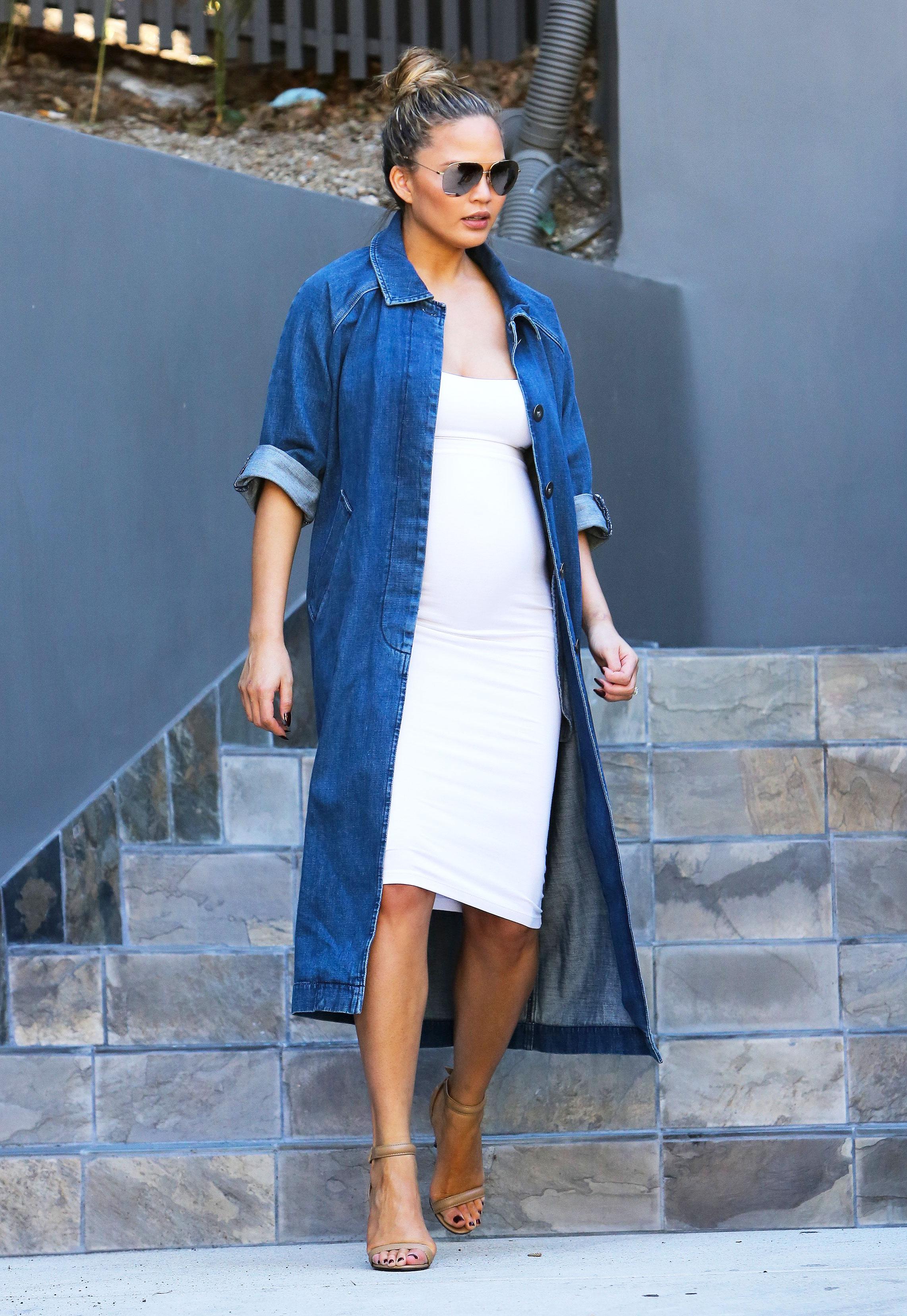 Pregnant Chrissy Teigen Pulls Off Denim Duster Coat
