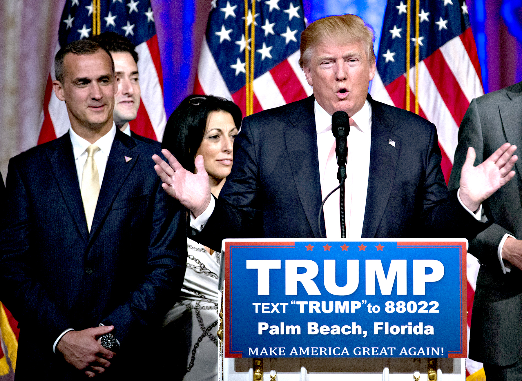Donald Trump, president and chief executive of Trump Organization Inc. and 2016 Republican presidential candidate, center, speaks during a news conference with Corey Lewandowski, campaign manager for Trump, left, at the Mar-A-Lago Club in Palm Beach, Florida, U.S., on Tuesday, March 15, 2016.