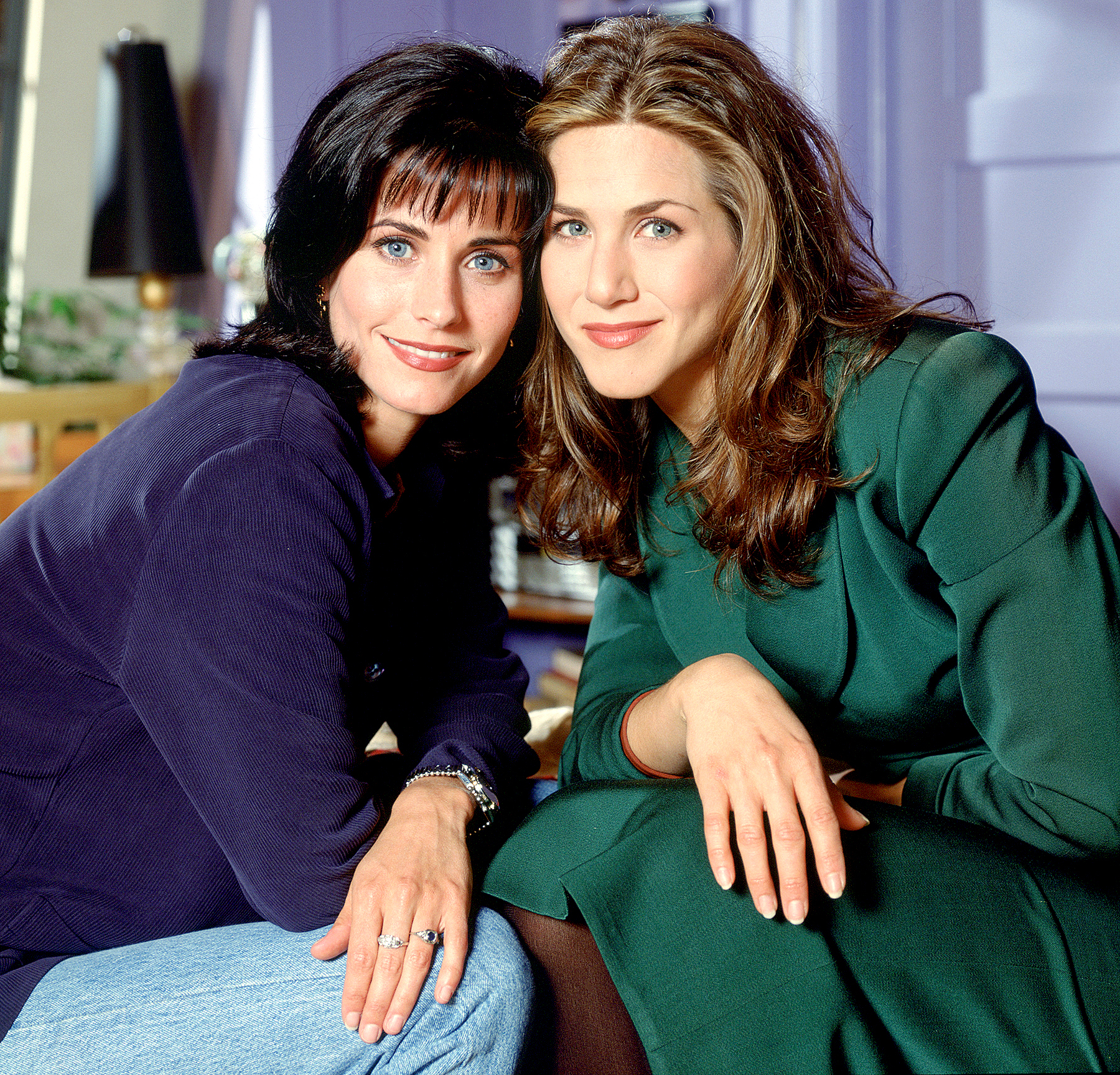 Courteney Cox Arquette as Monica Geller and Jennifer Aniston as Rachel Green on Friends.