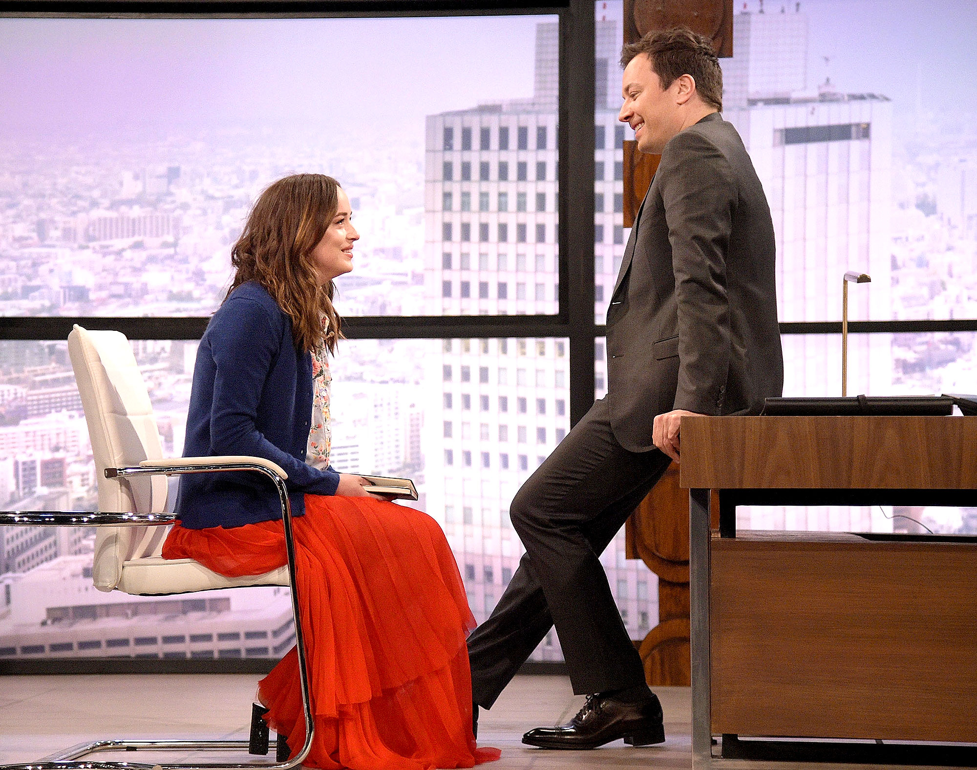 Dakota Johnson can't control her giggles on The Tonight Show with Jimmy Fallon