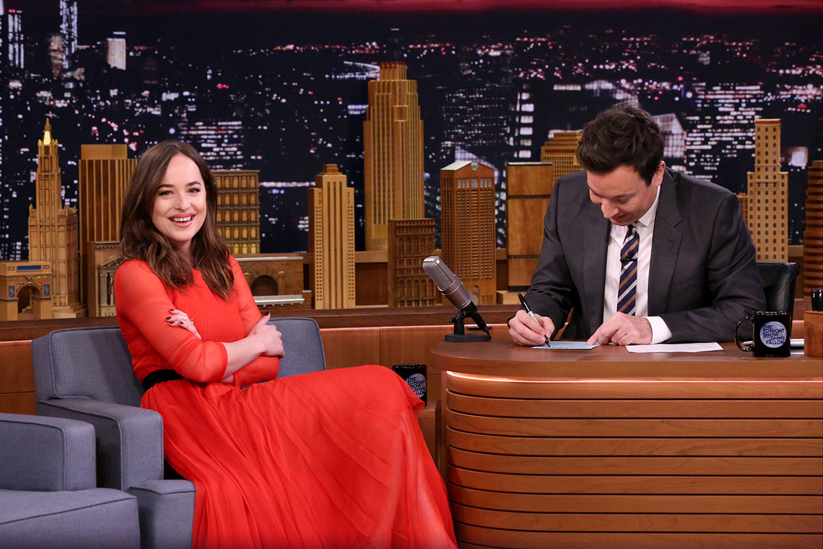 Dakota Johnson looked stunning in a red dress as she chatted to host Jimmy Fallon about her new movie 'Fifty Shades Darker'