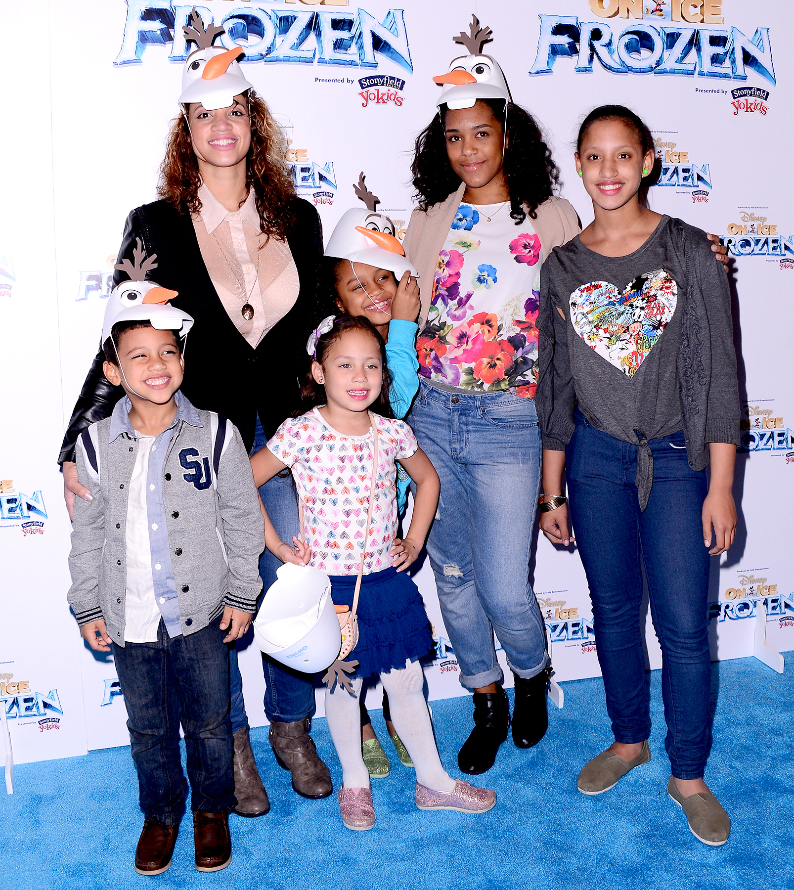 Dascha Polanco and her family attend Disney On Ice presents Frozen at Barclays Center on November 11, 2014 in New York City.