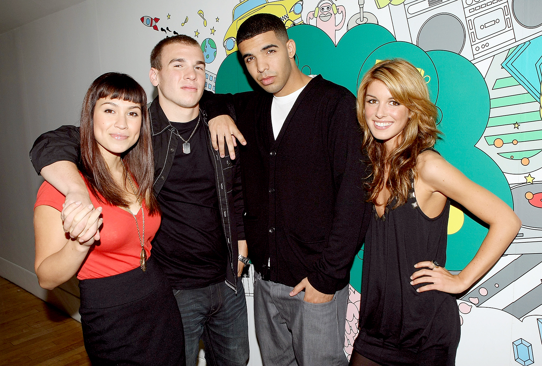 """""""DeGrassi High"""" cast members (L-R) Cassie Steele, Shane Kippel, Aubrey Graham, and Shenae Grimes pose for a photo backstage during MTV's Total Request Live at the MTV Times Square Studios on October 2, 2007 in New York City."""