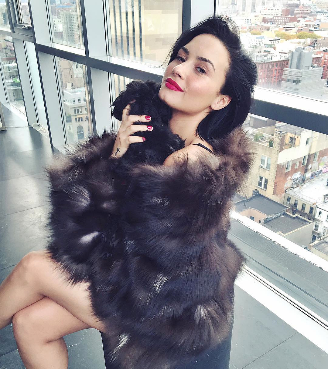 bb9dfea88 Demi Lovato Sparks Outrage Wearing a Fur Coat While Cuddling Her Dog: Pic
