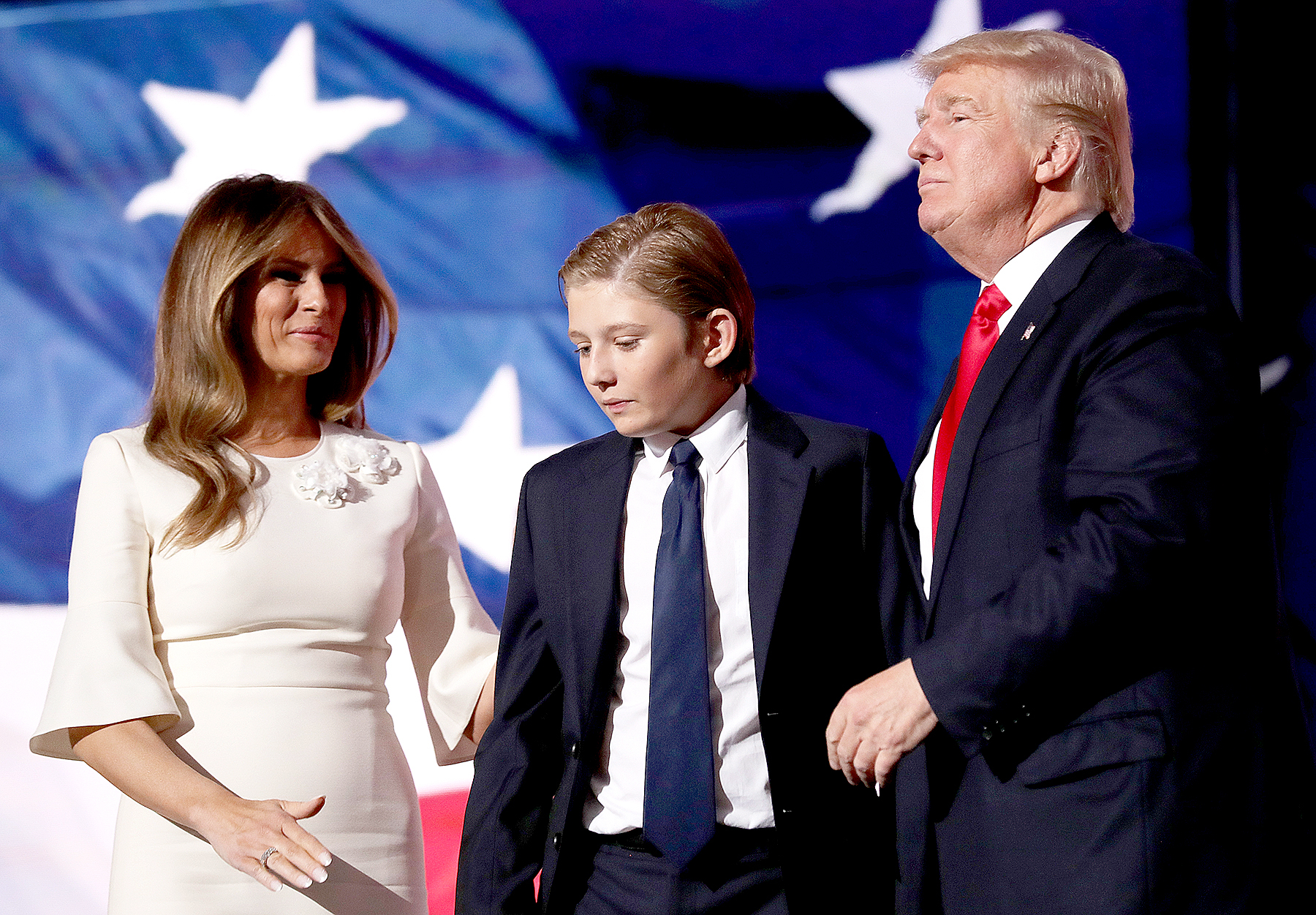 Republican presidential candidate Donald Trump (R) embraces his son Barron Trump, as his wife Melania Trump looks on at the end of the Republican National Convention on July 21, 2016 at the Quicken Loans Arena in Cleveland, Ohio.