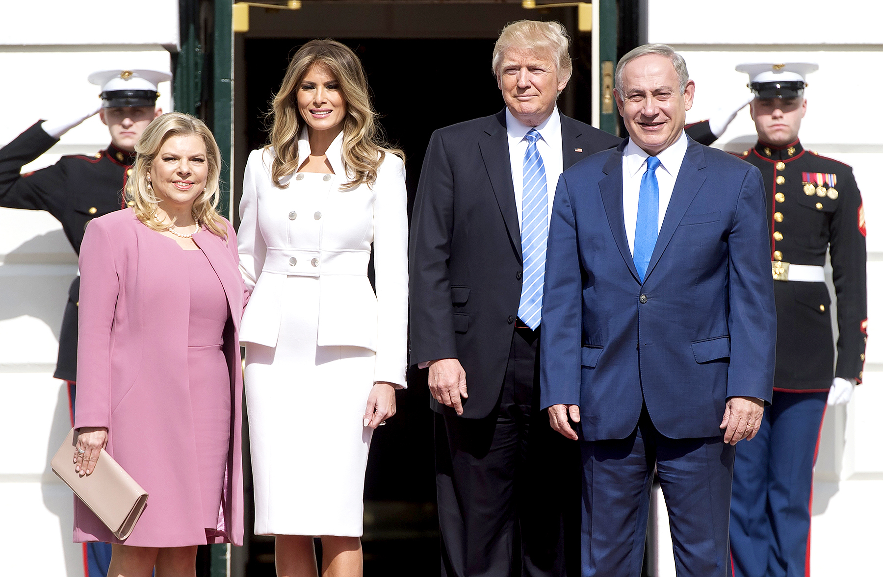 US President Donald Trump (C-R) and Israeli Prime Minister Benjamin Netanyahu (R), along with their wives, First Lady Melania Trump (C-L) and Sara Netanyahu (L), pose at the White House in Washington, DC, February 15, 2017.