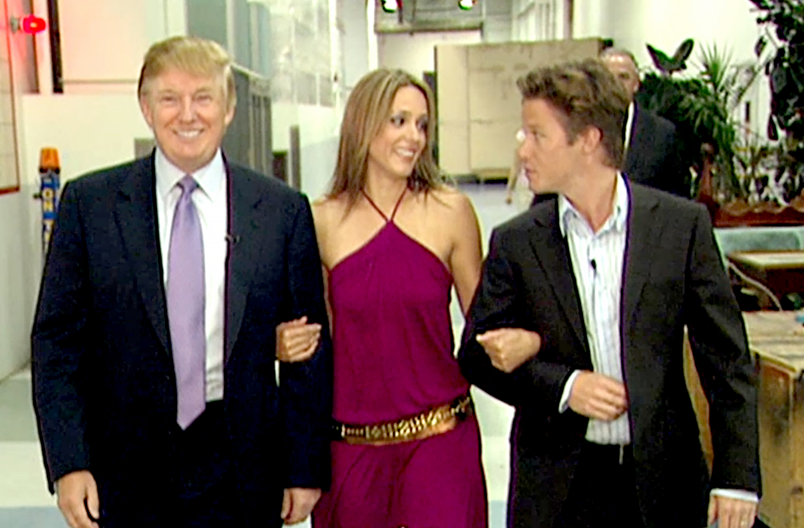 VIDEO FRAME GRAB: In this 2005 frame from video, Donald Trump prepares for an appearance on 'Days of Our Lives' with actress Arianne Zucker (center). He is accompanied to the set by Access Hollywood host Billy Bush.