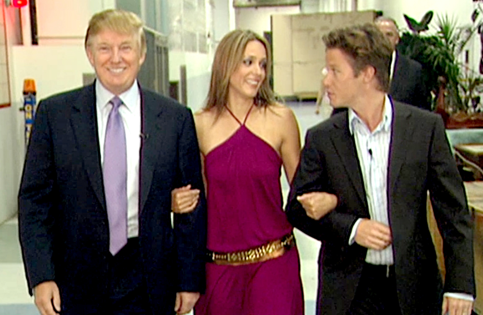 In this 2005 frame from video, Donald Trump prepares for an appearance on 'Days of Our Lives' with actress Arianne Zucker (center). He is accompanied to the set by Access Hollywood host Billy Bush.