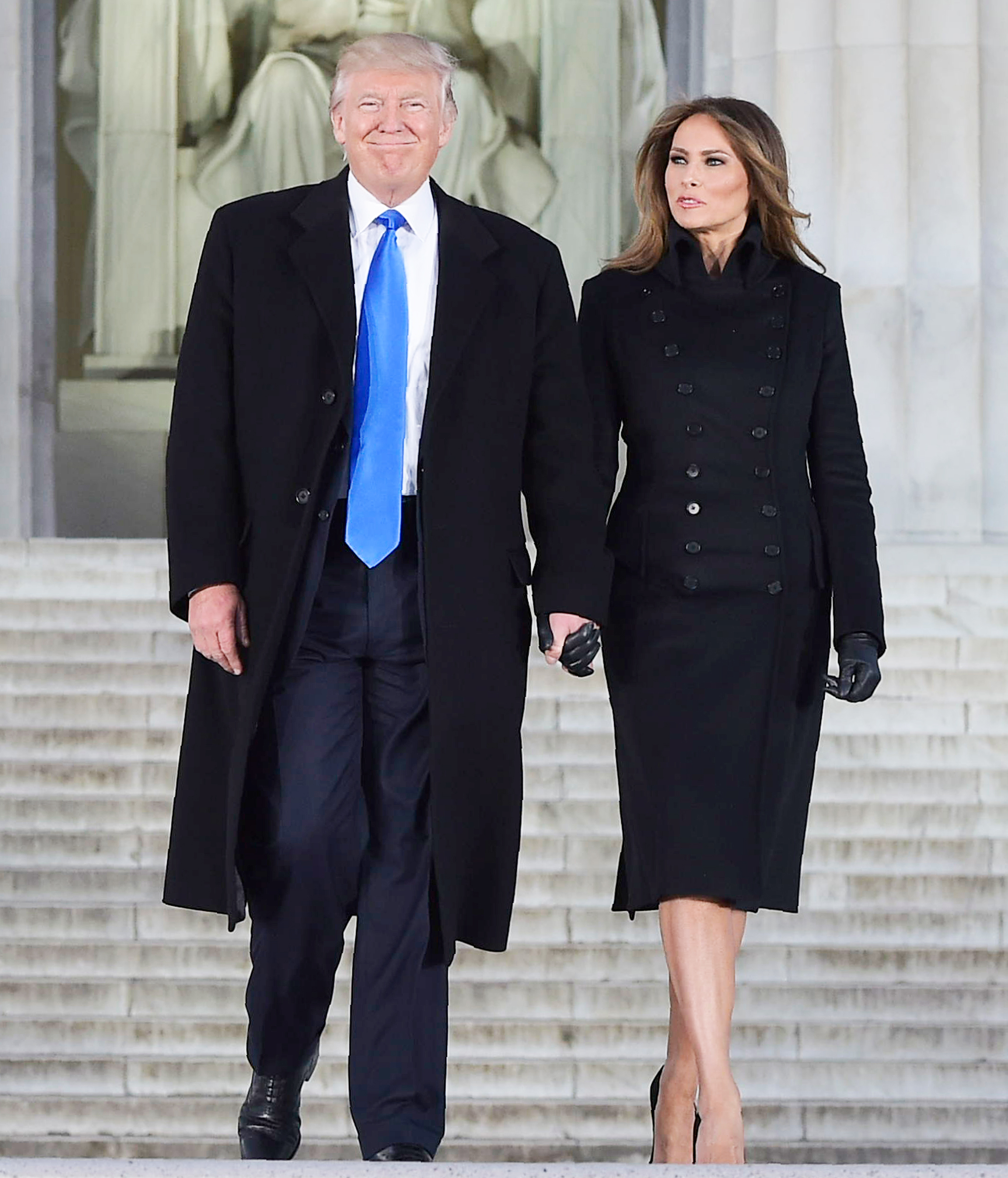 US President-elect Donald Trump and his wife Melania arrive to attend an inauguration concert at the Lincoln Memorial in Washington, DC, on January 19, 2017.