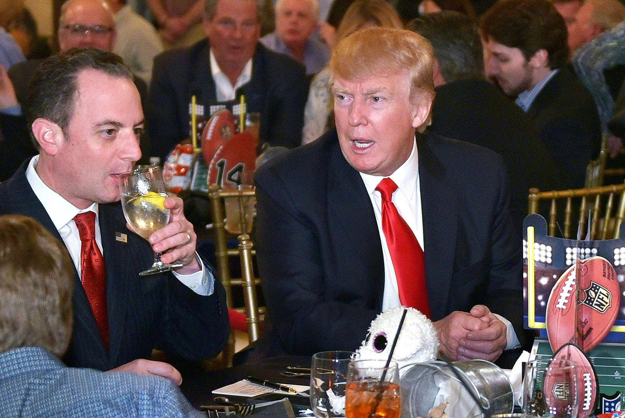 Donald Trump chats with White House Chief of Staff Reince Priebus while watching Super Bowl LI at Trump International Golf Club Palm Beach in West Palm Beach, Florida on February 5, 2017. /