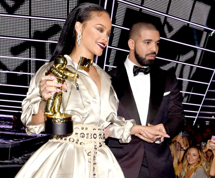 Rihanna accepts the Video Vanguard award from Drake onstage during the 2016 MTV Video Music Awards.
