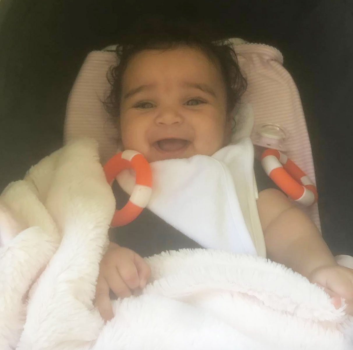 """Rob Kardashian shared a cute photo of his smiling 5-month-old baby daughter on March 29, 2017. """"Baby Dream!! Thank you God,"""" the sock designer captioned the Instagram snap."""