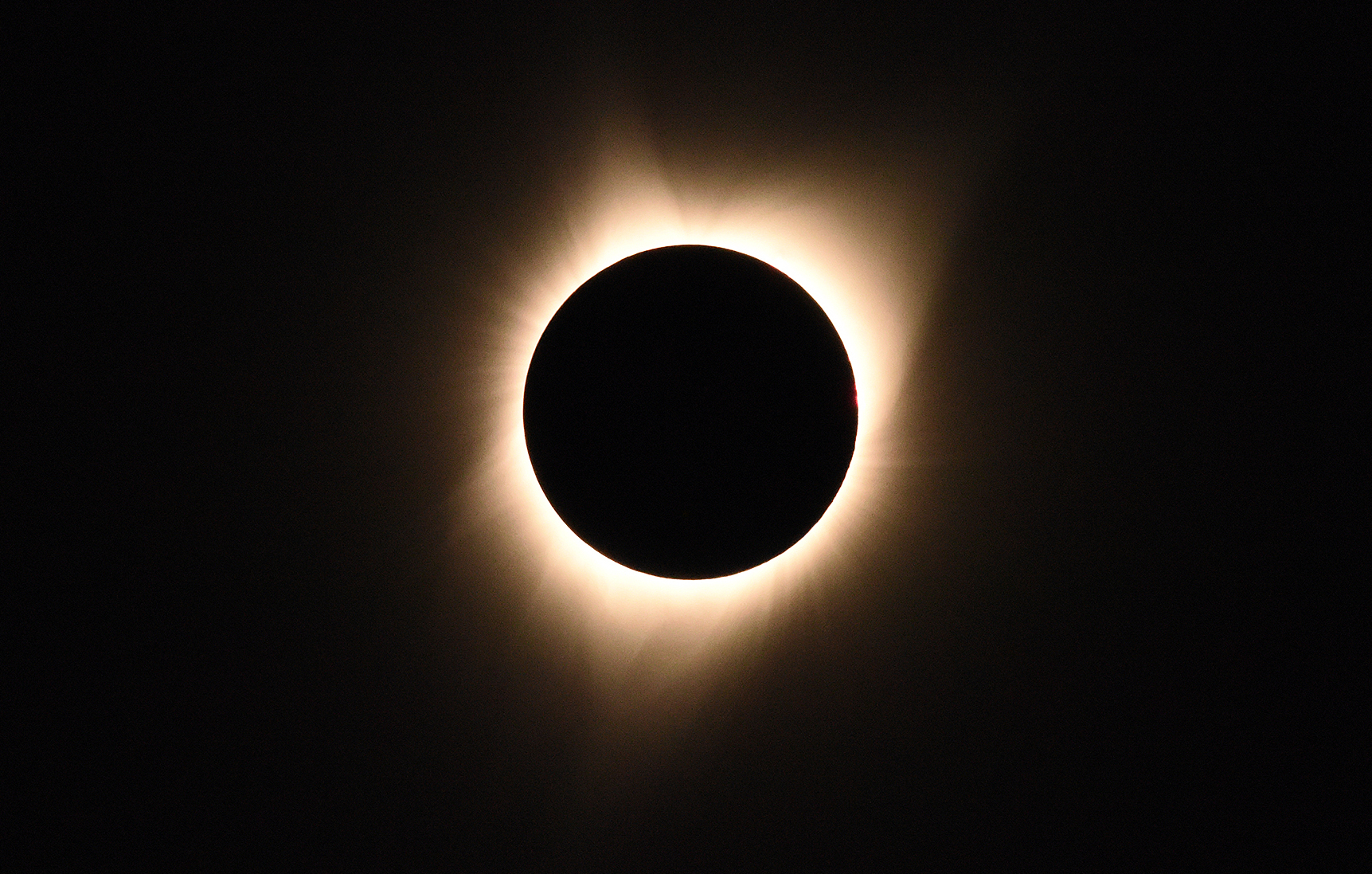 The sun's corona is visible as the moon passes in front of the sun during a total solar eclipse at Big Summit Prairie ranch in Oregon's Ochoco National Forest near the city of Mitchell on August 21, 2017.