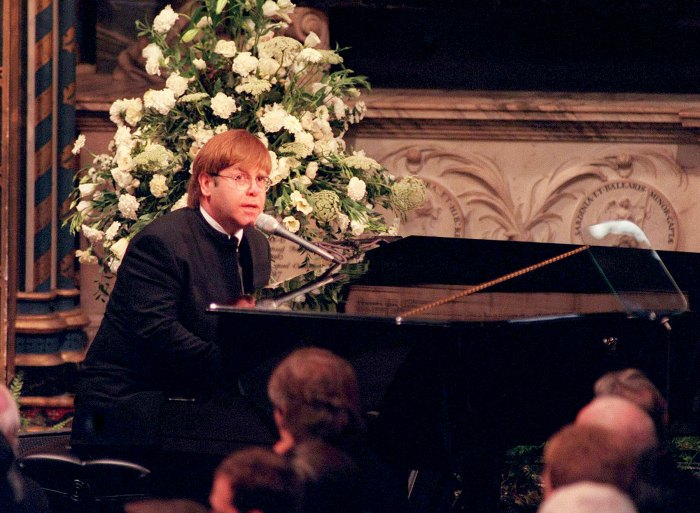 Sir Elton John signing 'Candle In The Wind' at the funeral of Diana, Princess of Wales on September 6, 1997.