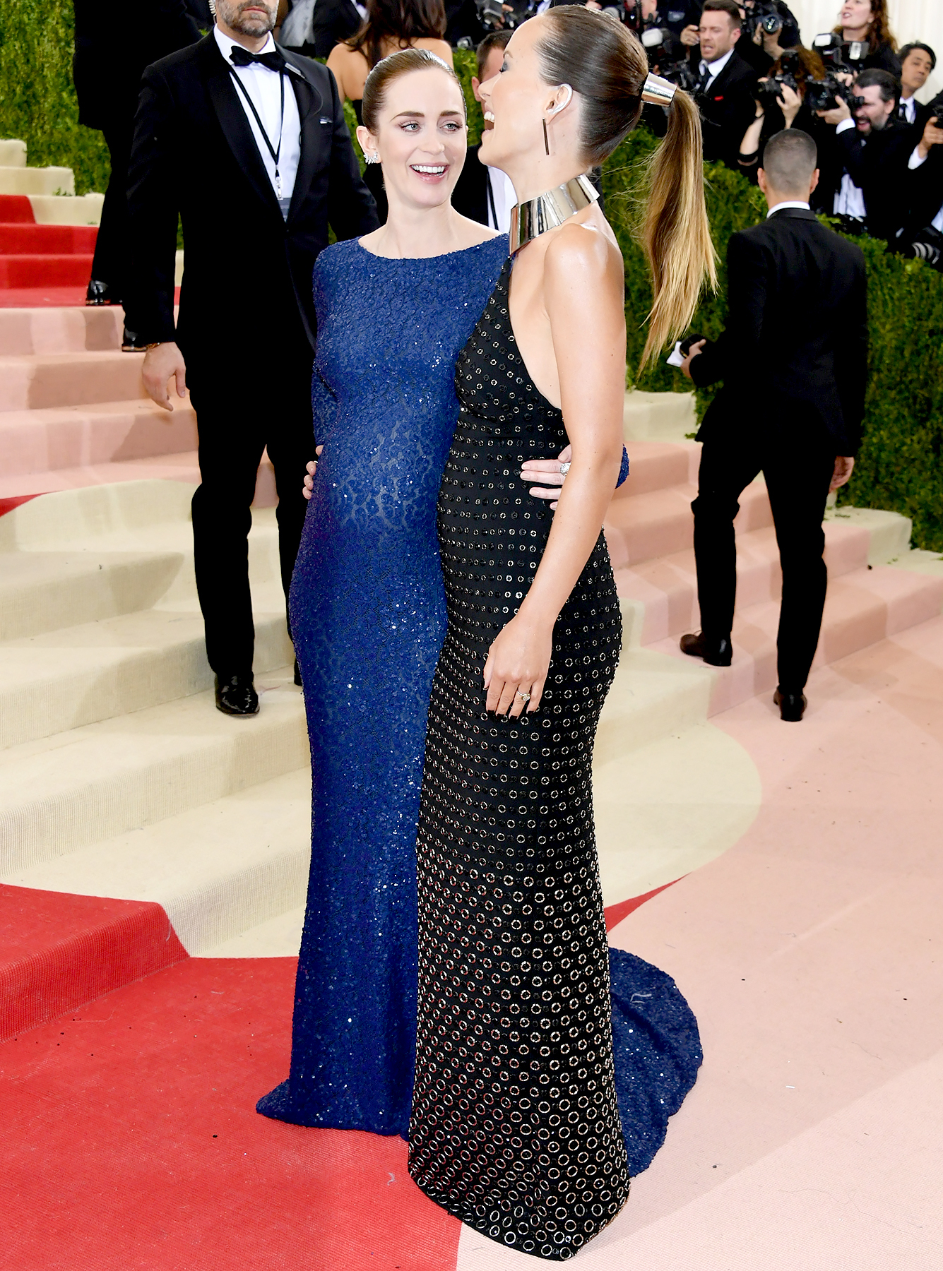 Emily Blunt (L) and Olivia Wilde attend the