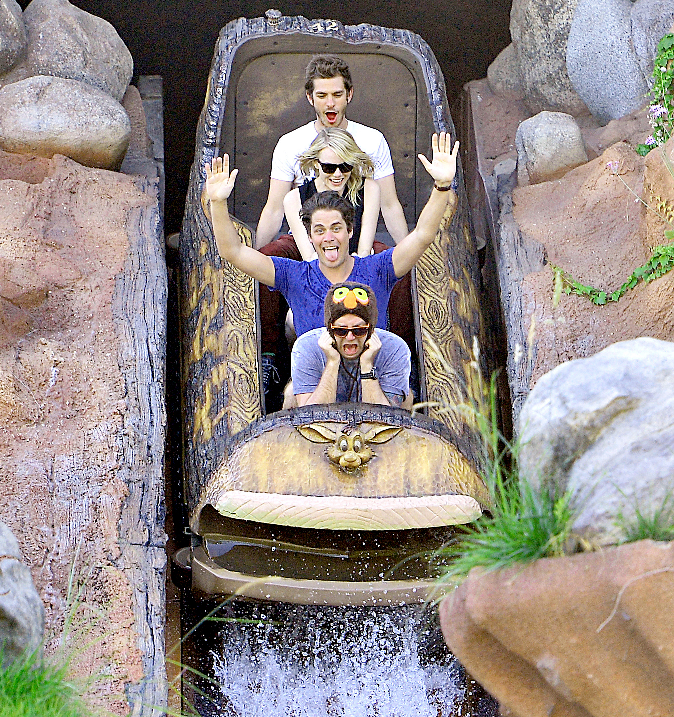Andrew Garfield continued his birthday celebration with a day at Disneyland with Emma Stone and friends in 2012.