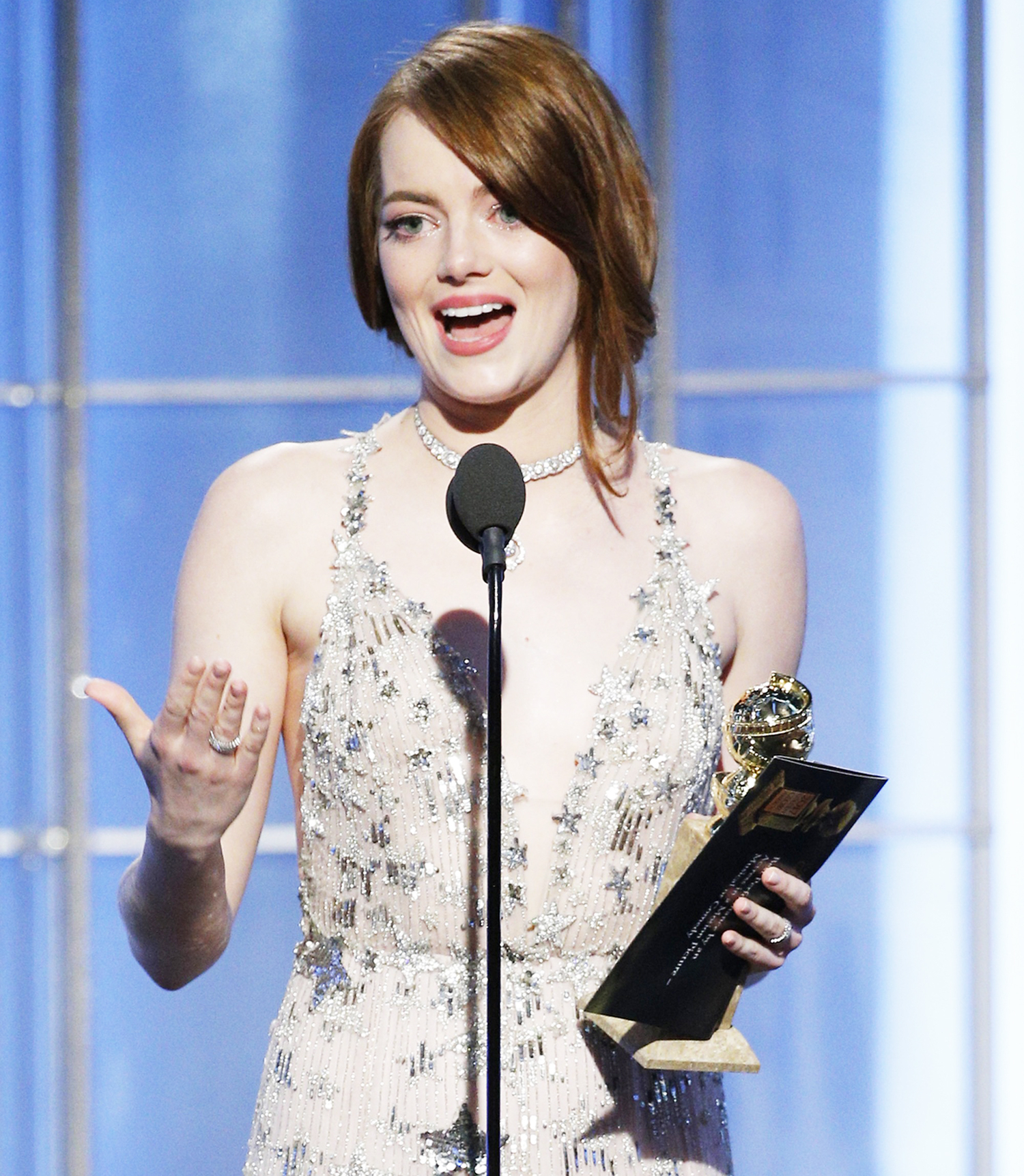 Emma Stone accepts the award for Best Actress in a Motion Picture - Musical or Comedy for her role in