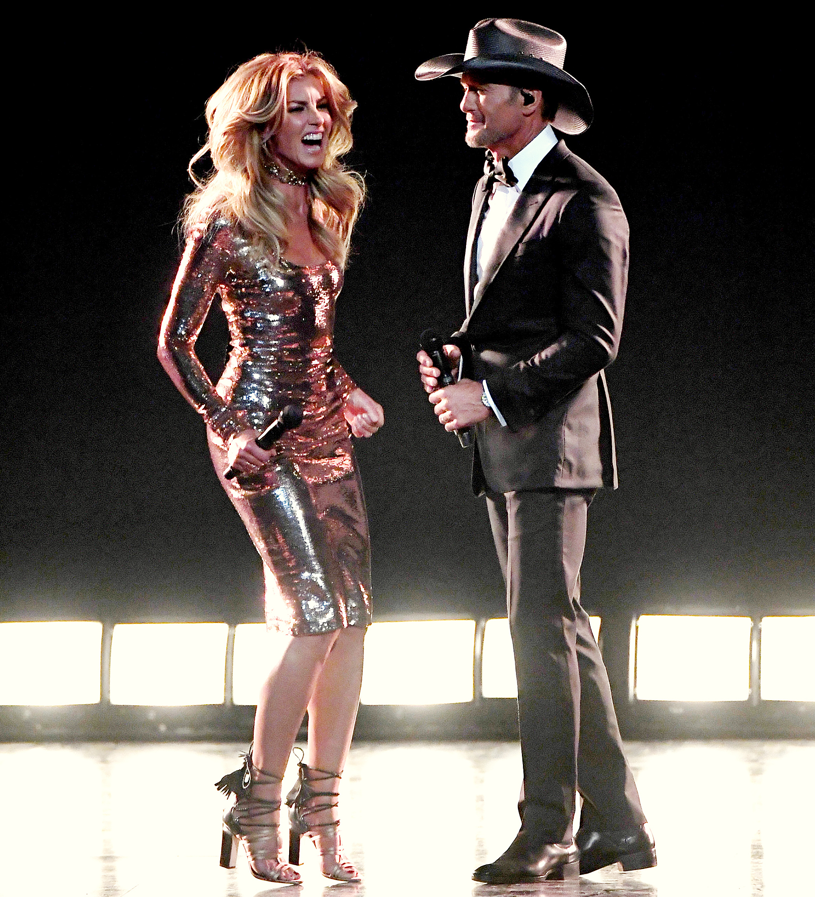Faith Hill Jumps Into Tim McGraw's Arms After ACM Awards