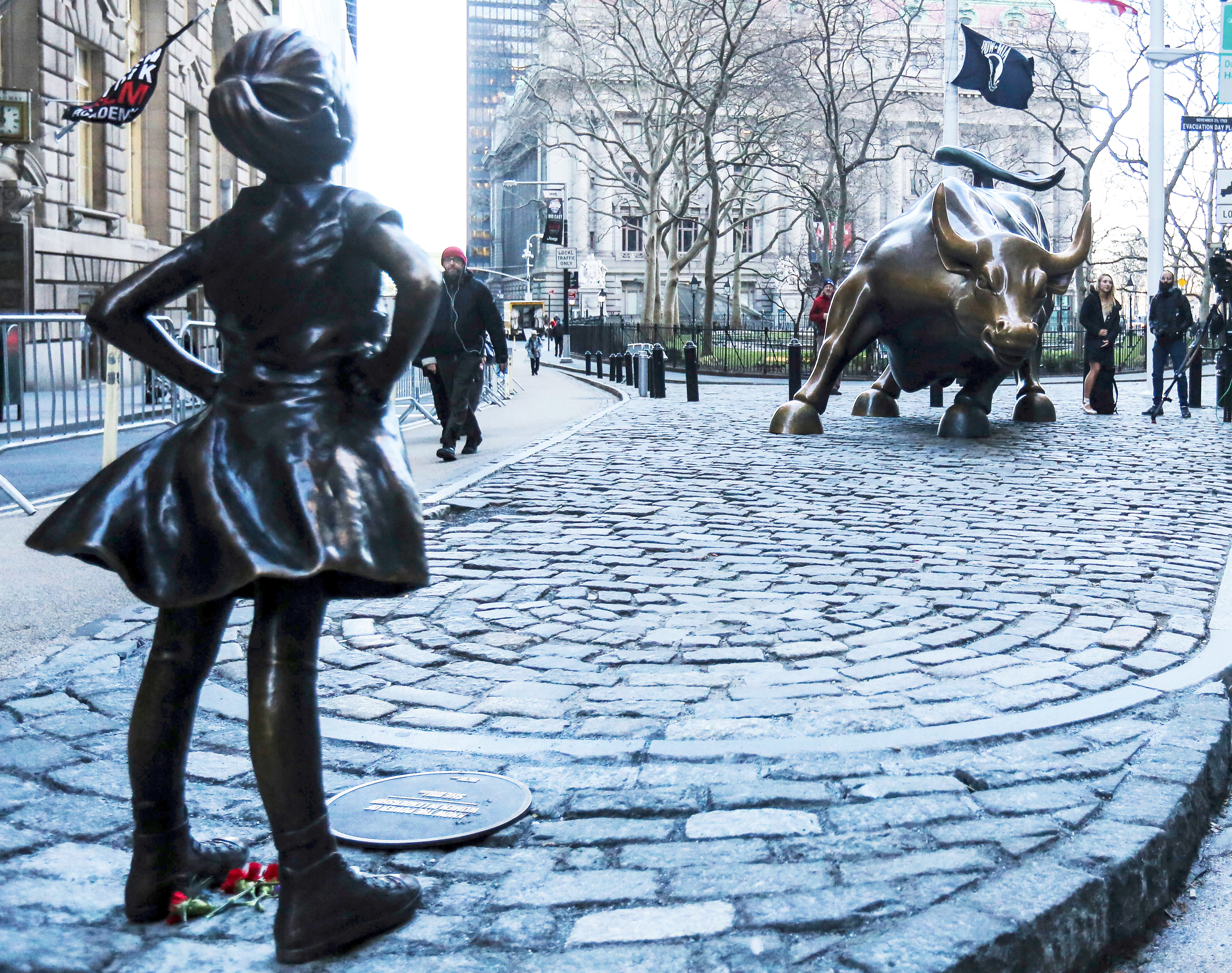 'The Fearless Girl' statue as it stands across from the Wall Street's famous Charging Bull