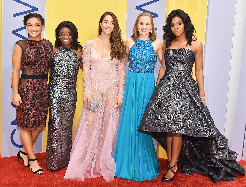 Laurie Hernandez, Simone Biles, Aly Raisman, Madison Kocian and Gabby Douglas (rom left) attend the 50th annual CMA Awards at the Bridgestone Arena on Nov. 2, 2016, in Nashville.