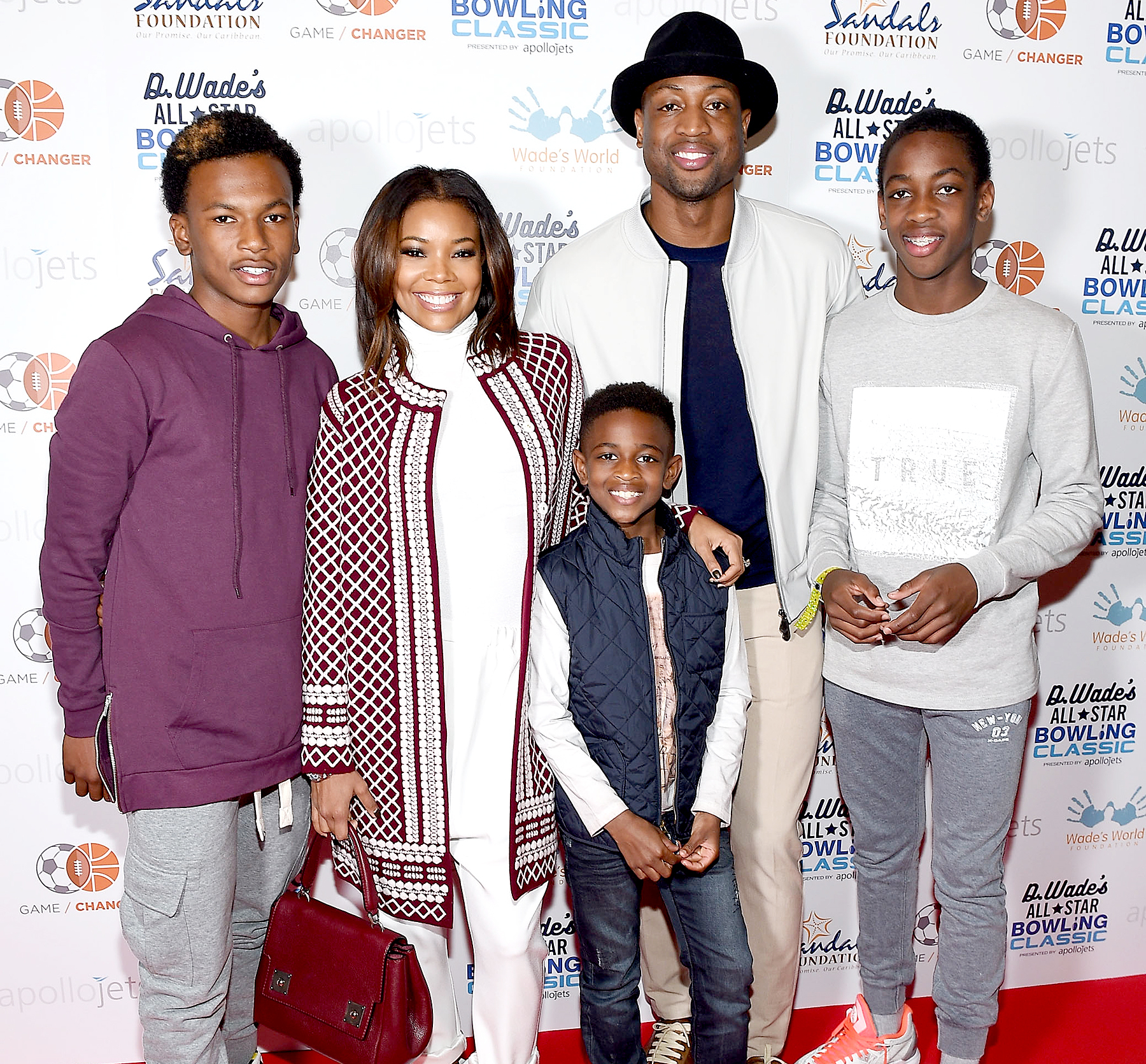 Dahveon Morris, Gabrielle Union, Zion Wade, Dwyane Wade, and Zaire Wade attend the DWade All Star Bowling Classic Benefitting The Sandals Foundation And Wade's World Foundation at The Ballroom on February 13, 2016.
