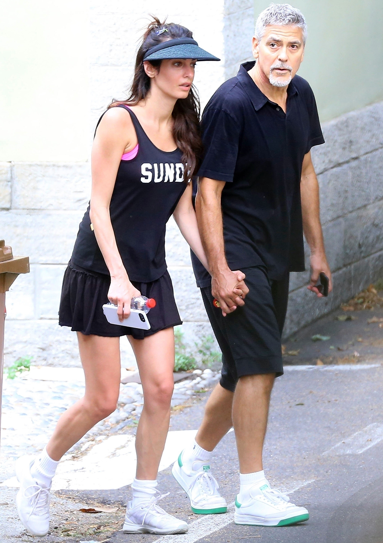 George Clooney and Amal Clooney head home after enjoying a tennis match together in Laglio, Italy, on August 17, 2017.