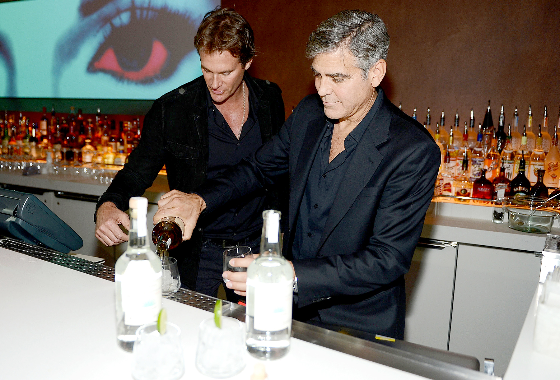 Casamigos Tequila founders Rande Gerber and George Clooney celebrate the launch of Casamigos at Andrea's at Encore Las Vegas on January 9, 2013 in Las Vegas, Nevada.