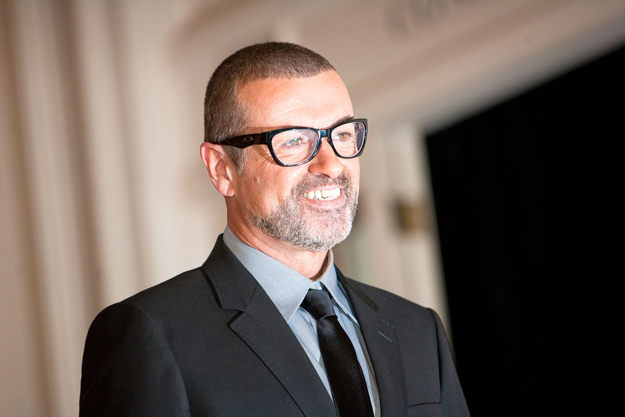 "George Michael poses for photos before announcing his ""Symphonica"" European Orchestral tour during a press conference at the Royal Opera House on May 11, 2011 in London, United Kingdom."