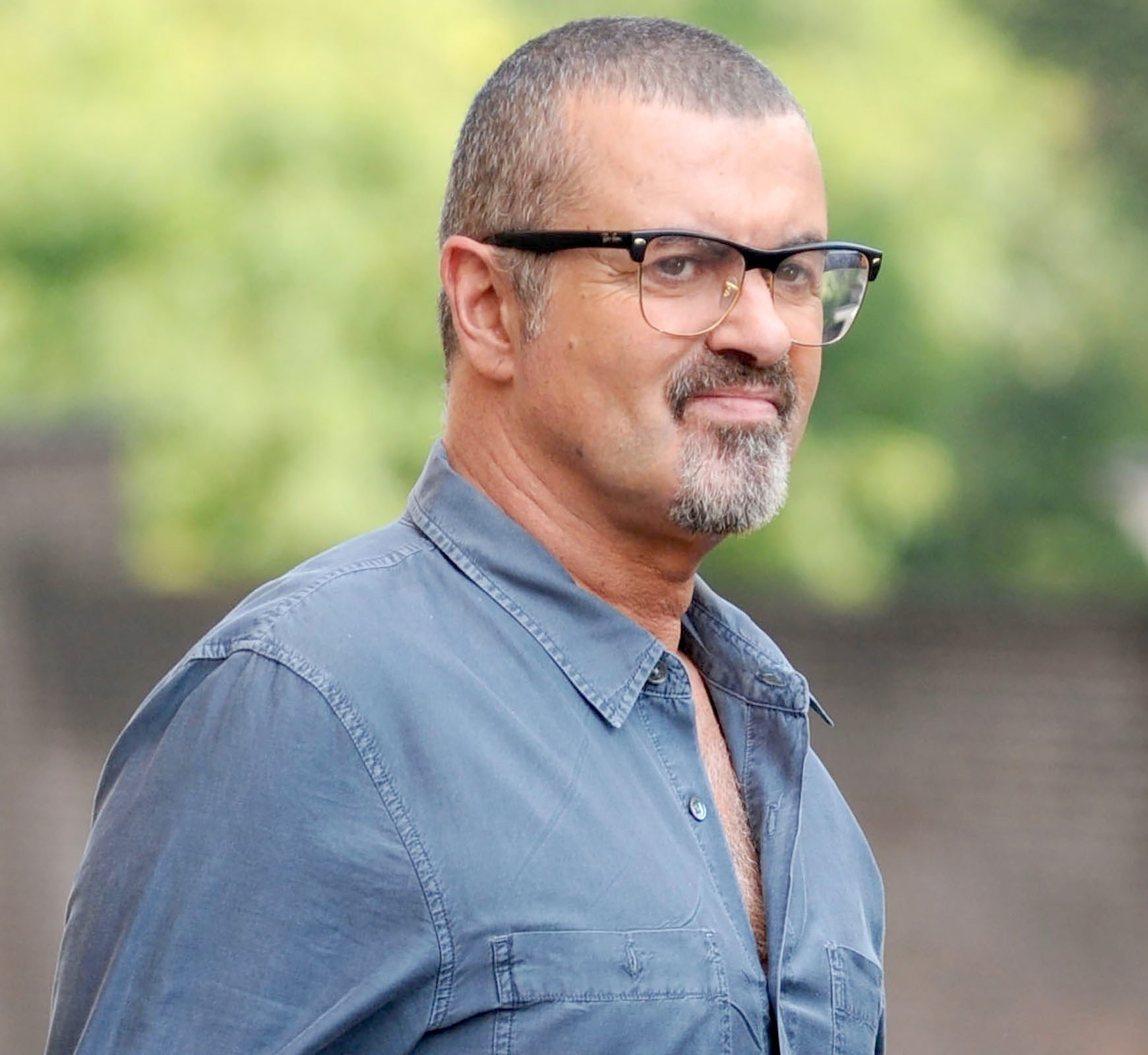George Michael leaves the Cote Brassiere restaurant in Highgate on August 25, 2013.