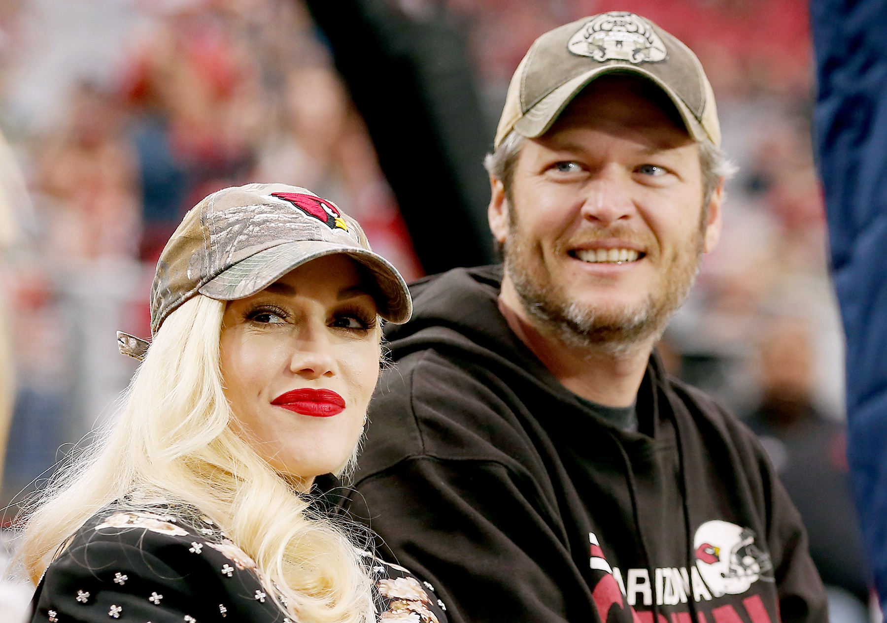 Gwen Stefani and Blake Shelton attend the NFL game between the Green Bay Packers and Arizona Cardinals at University of Phoenix Stadium on December 27, 2015.