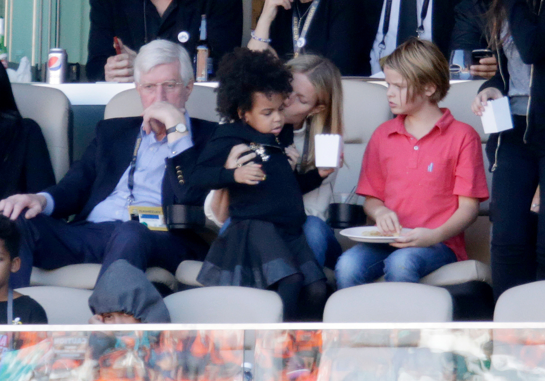 Gwyneth Paltrow holds Jay-Z and Beyonce's daughter Blue Ivy Carter as she attends the 2016 Super Bowl with her children Apple and Moses Martin in Santa Clara, California on February 7, 2016.