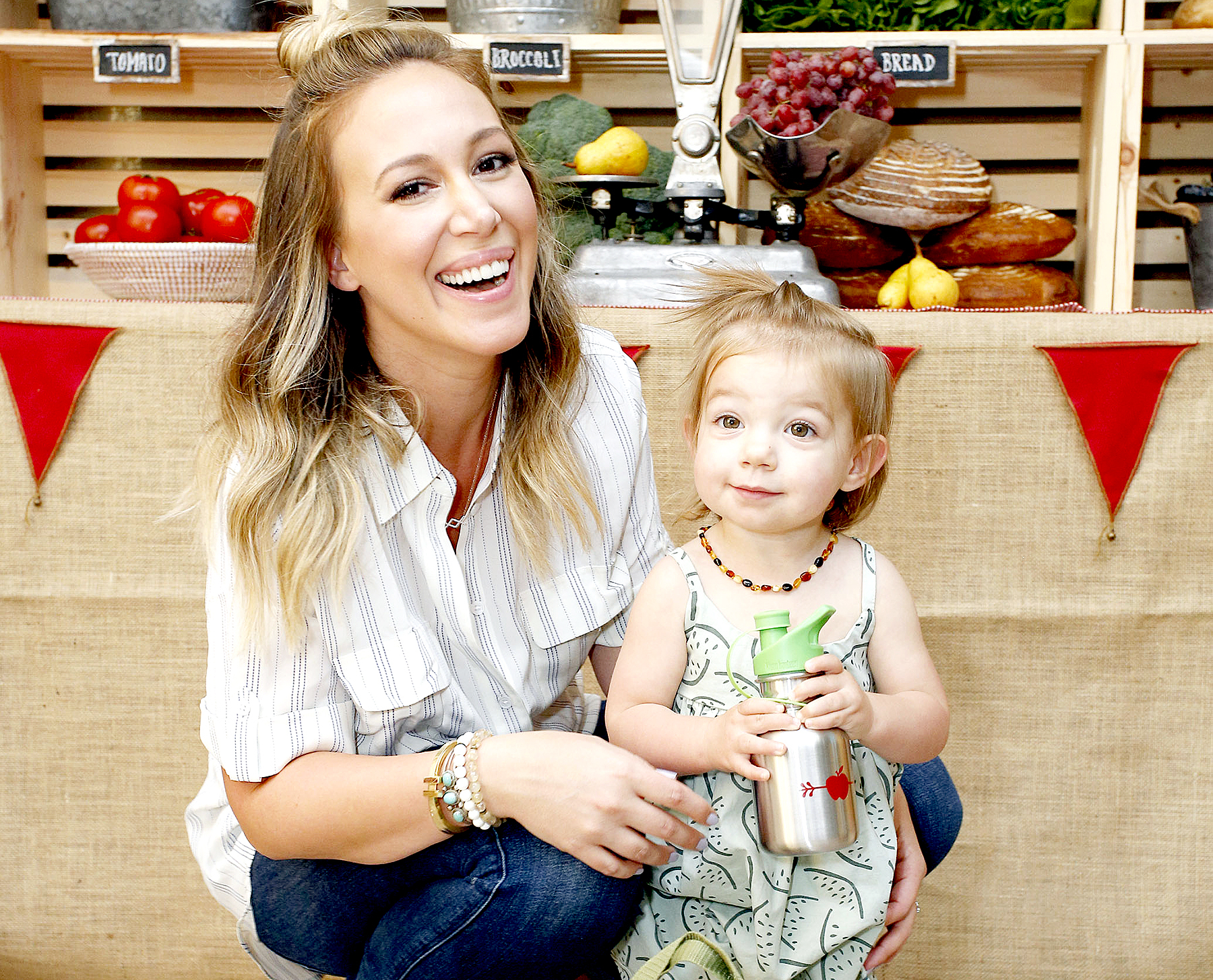 Haylie Duff and daughter Ryan Ava Rosenberg attend Haylie Duff Hosts Applegate's Sandwich Soiree at AU FUDGE on September 29, 2016 in West Hollywood, California.