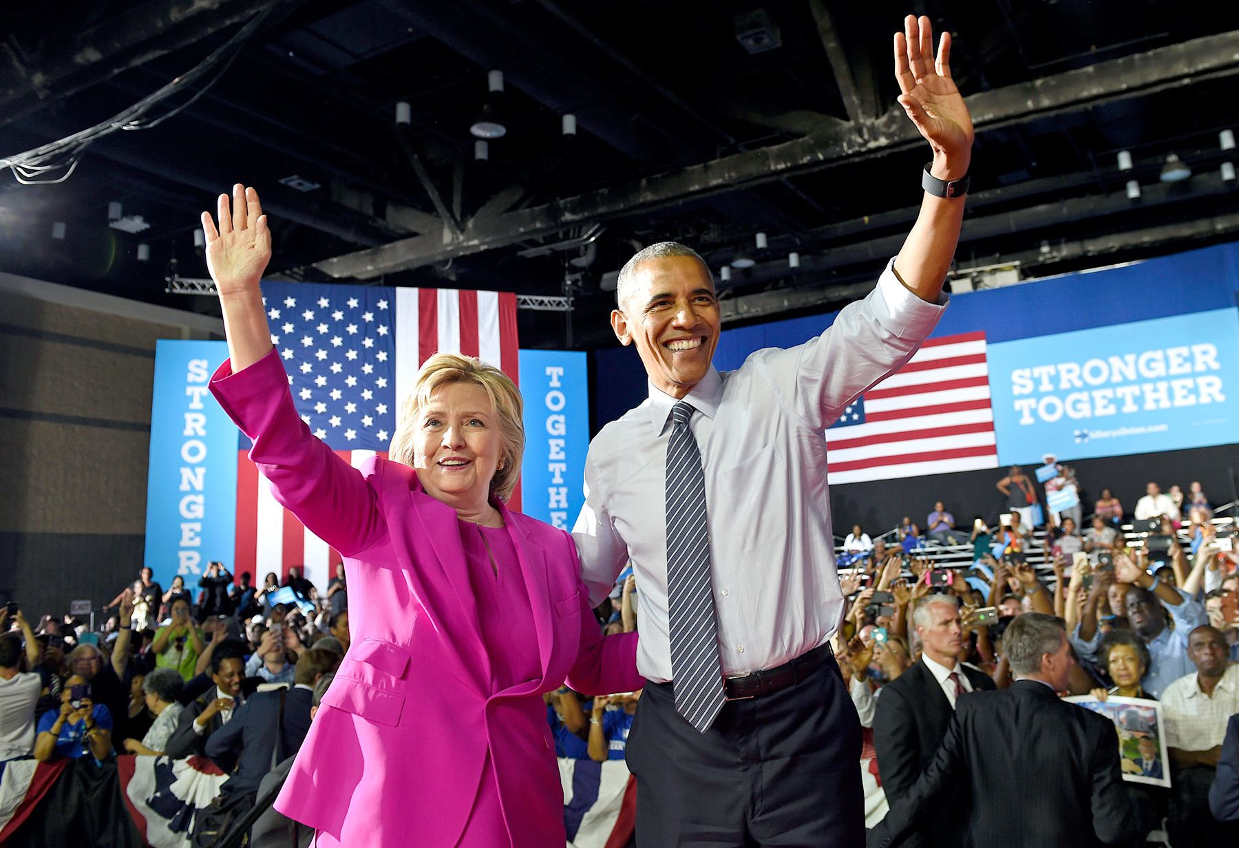 President Barack Obama and Democratic presidential candidate Hillary Clinton wave following a campaign event at the Charlotte Convention Center in Charlotte, N.C., Tuesday, July 5, 2016.