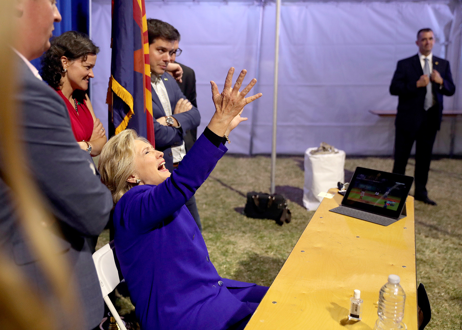 Democratic presidential candidate Hillary Clinton watches the World Series baseball game between the Chicago Cub and the Cleveland Indians after her final campaign rally of the day at Arizona State University in Tempe, Ariz., Wednesday, Nov. 2, 2016.