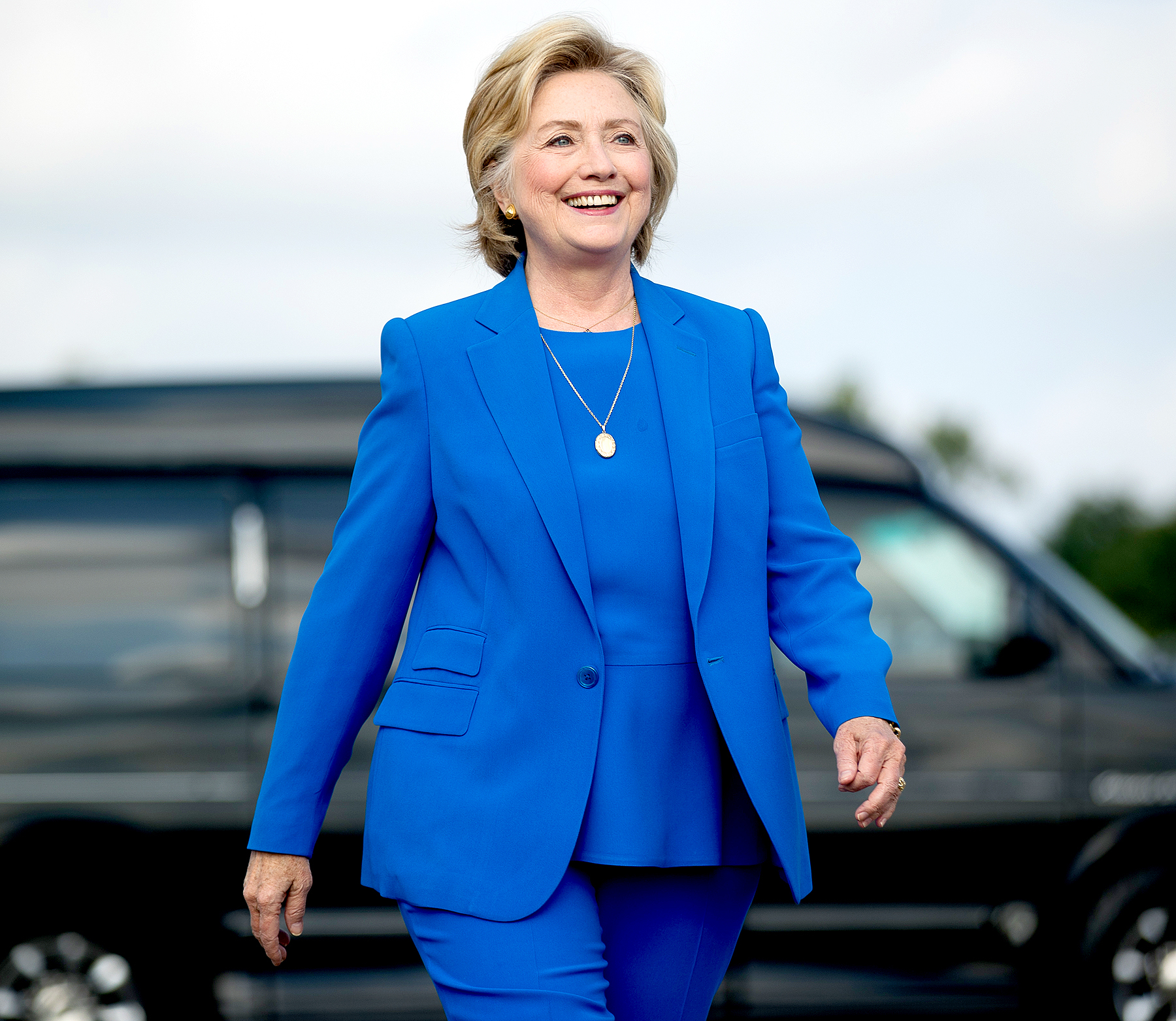 Democratic presidential candidate Hillary Clinton arrives to speak to members of the media before boarding her campaign plane at Westchester County Airport in White Plains, N.Y., Thursday, Sept. 8, 2016, to travel to Charlotte, N.C., to attend a campaign rally.