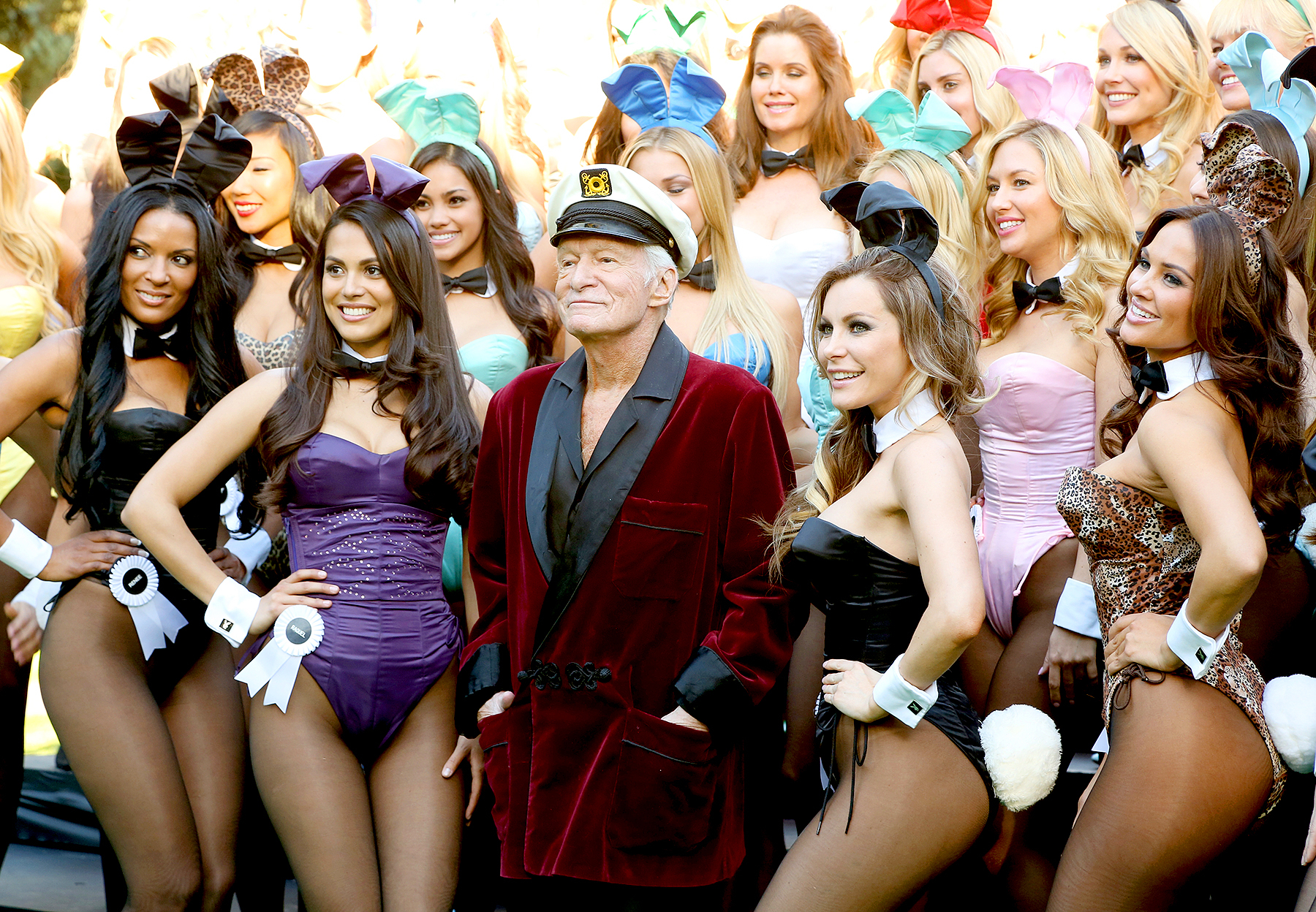 Hugh Hefner (C) poses with Playboy Bunnies, Playmate of the Year 2013 Raquel Pomplun (2nd L) and Miss December 2009 Crystal Hefner (2nd R) at Playboy's 60th Anniversary special event on January 16, 2014 in Los Angeles, California.