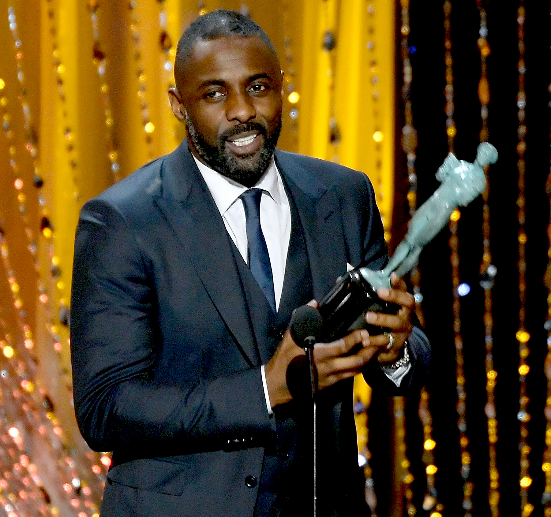 Idris Elba accepts the Outstanding Performance by a Male Actor in a Supporting Role award for
