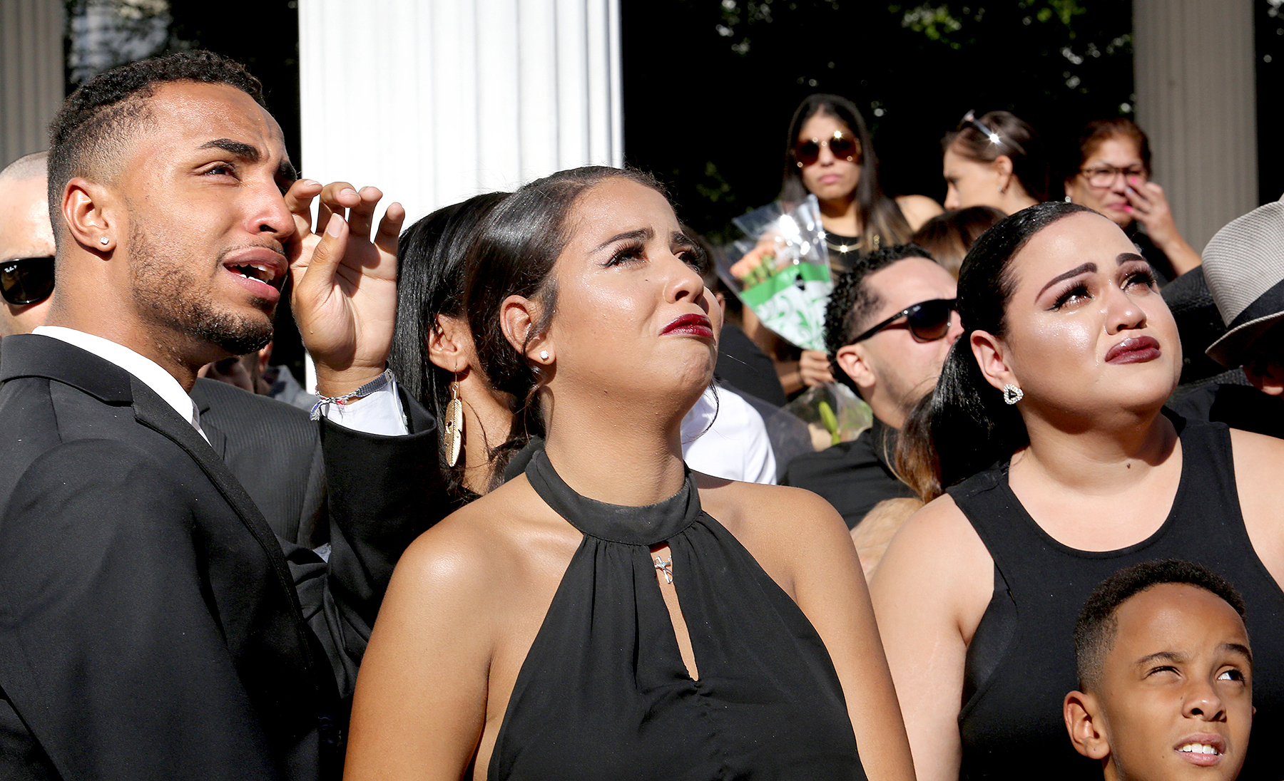 Isaiah Henderson, Tatiana Harris, center, and Khiana Marshall watch 49 white balloons after they were released during the funeral for their mother, Pulse shooting victim Brenda Lee Marquez McCool, at First United Methodist Church in Orlando, Fla., Monday, June 20, 2016.